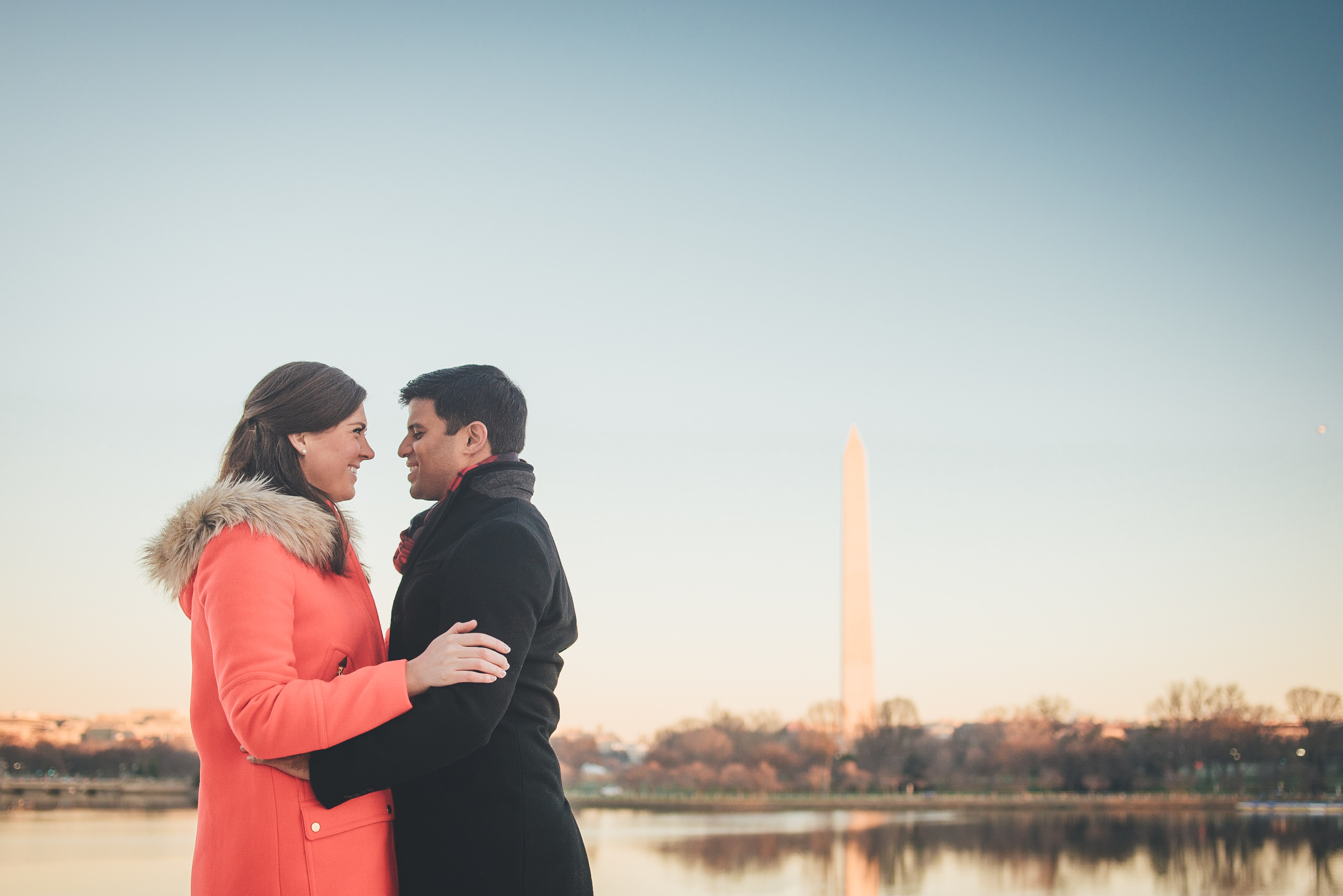 Joe & Christina embrace for an engagement photo on a cold January morning in Washington DC.