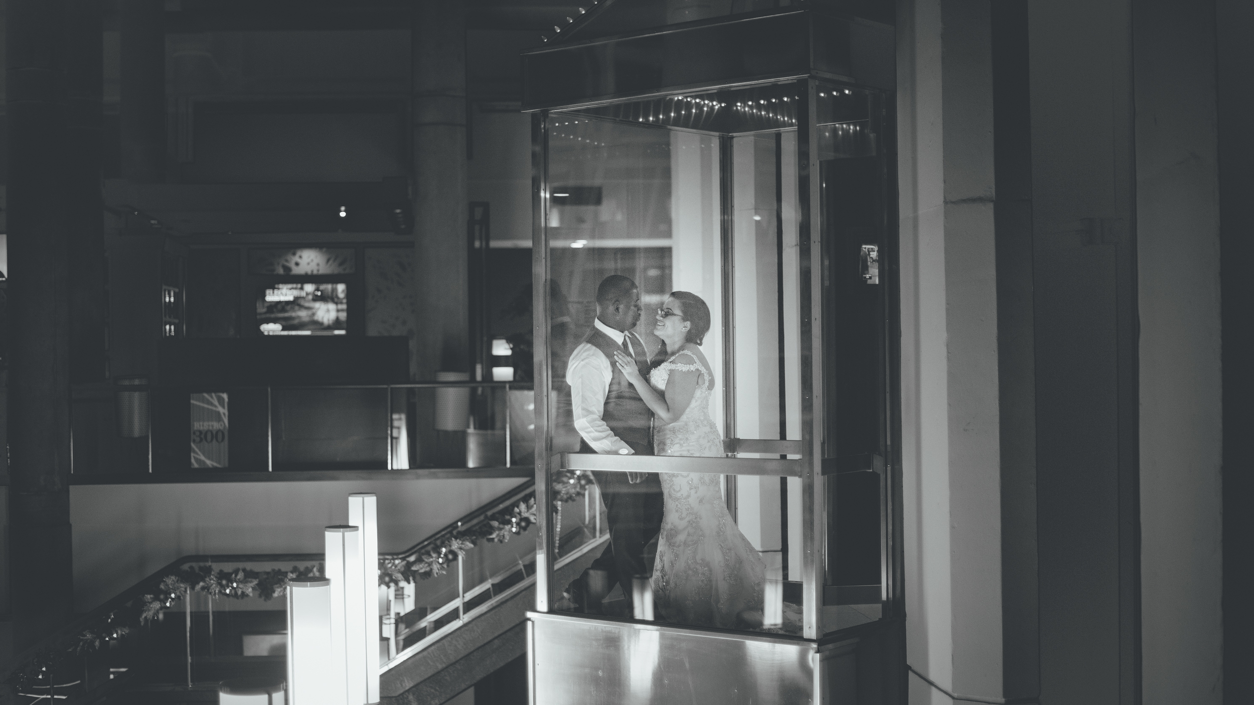 Jasmine and Aaron take a break from dancing to share a moment alone in the Inner Harbor Hyatt's famous all glass elevator....I was there to sneek a photo...or two...