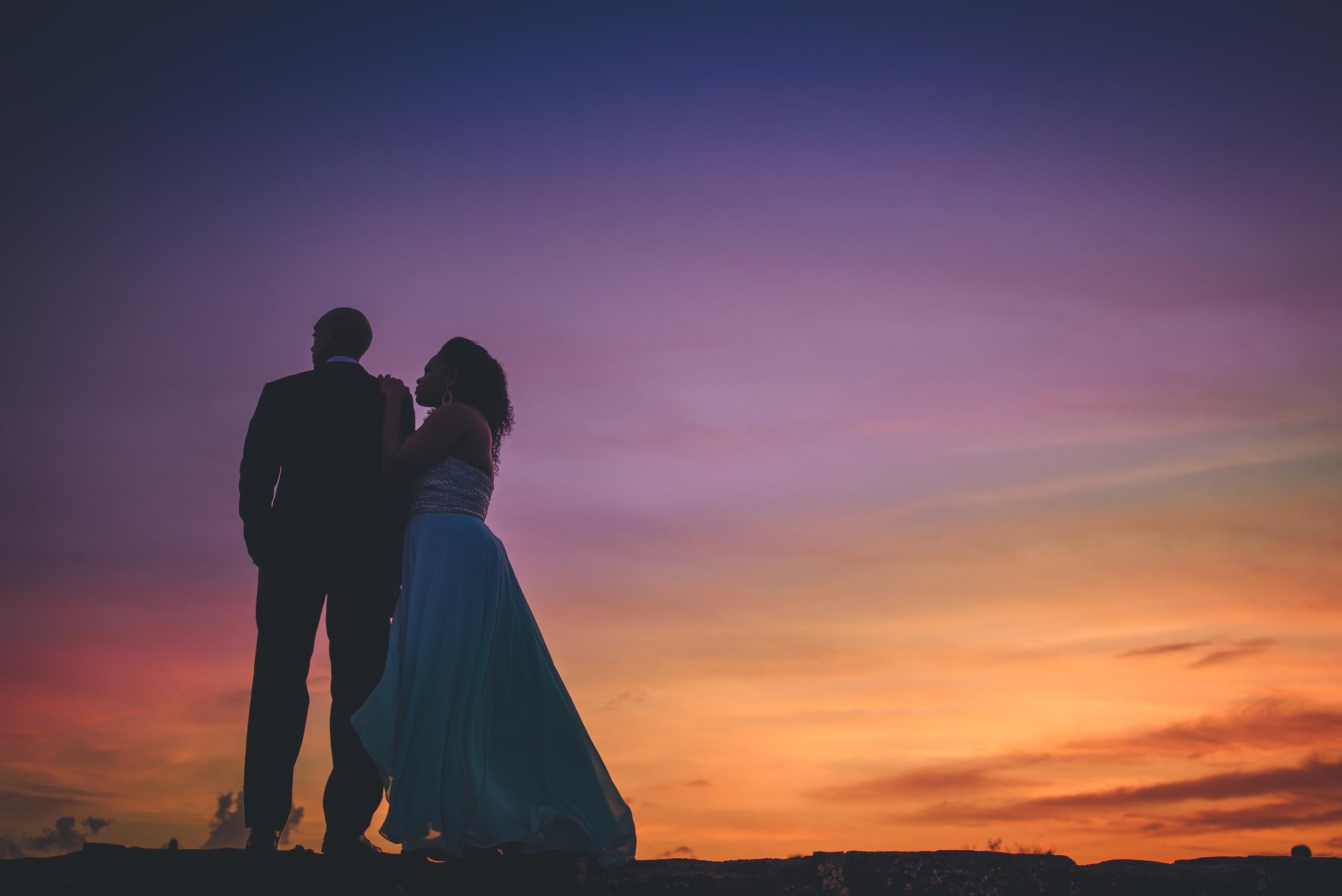 couplesposesatsunsetinstaugustine