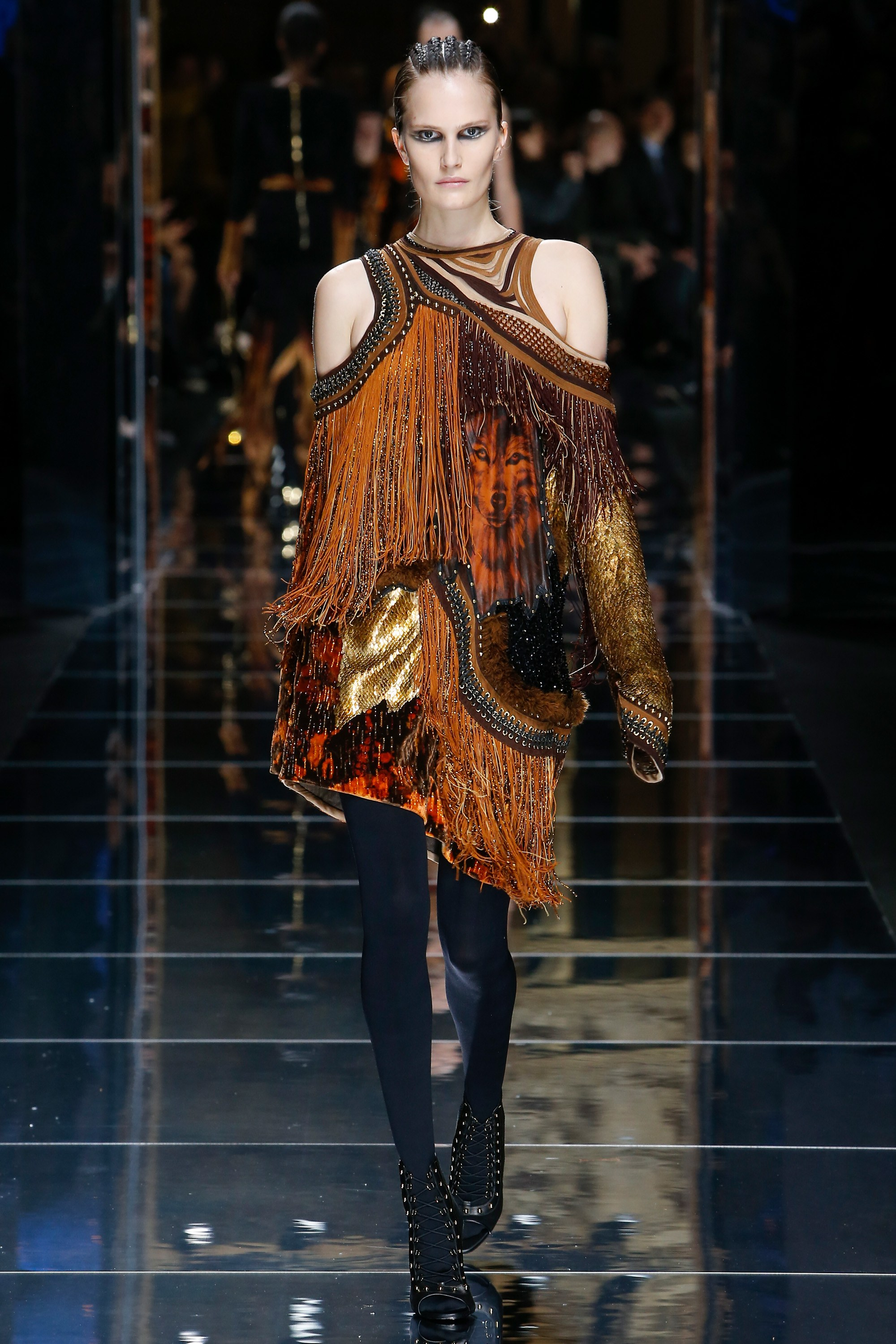 BALMAIN -  loved every piece in this collection, each piece embellished to within an inch of it's life with flashes of gilt and gold..... inspired here by Fringe in suede and leather
