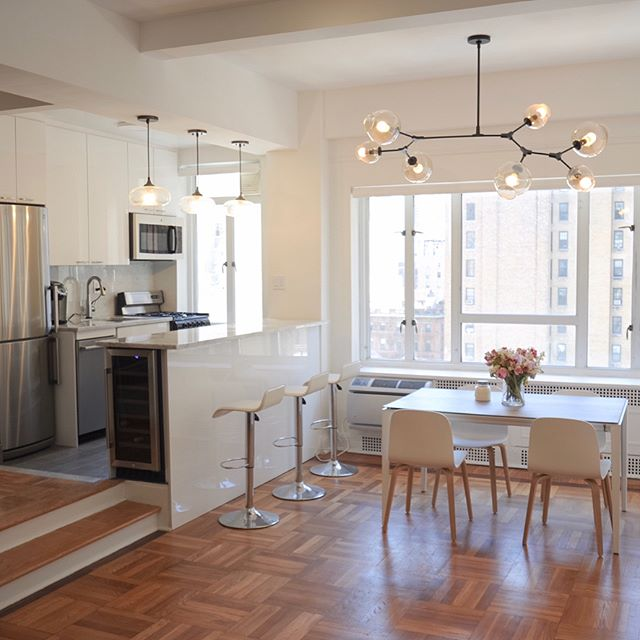 Madison Ave NYC renovation complete. We knocked down a wall to make it an open kitchen floor plan, ripped out carpet and refinished the floors, drop ceiling for lighting, custom cabinets and kitchen island with wine fridge.