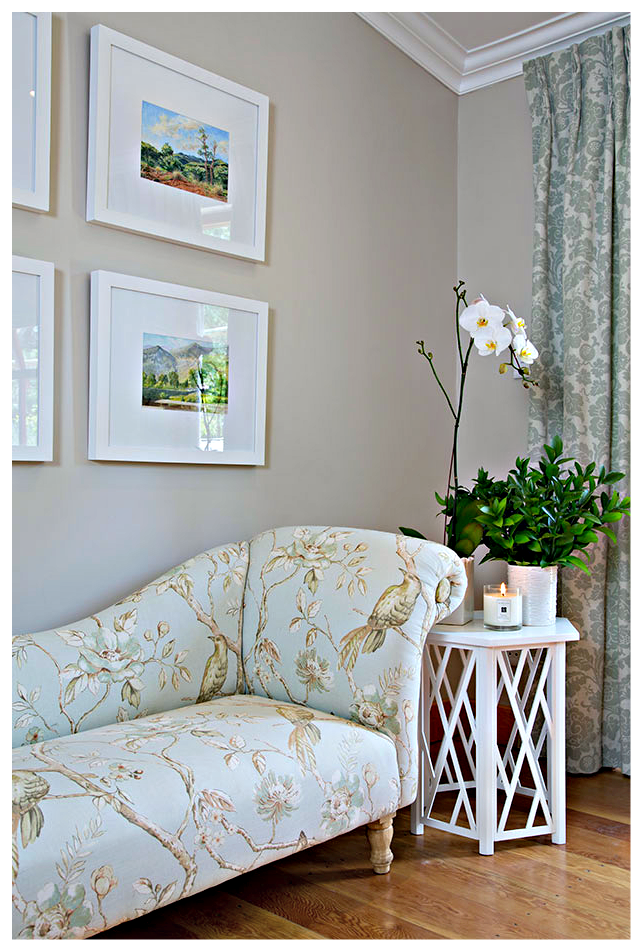 White boxed framed art brings a fresh contemporary element to the more traditional custom made chaise.