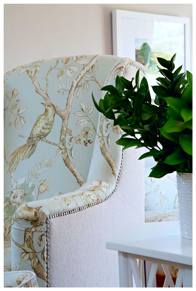 Beautifully upholstered armchairs featuring a plain fabric backing and pattern front.