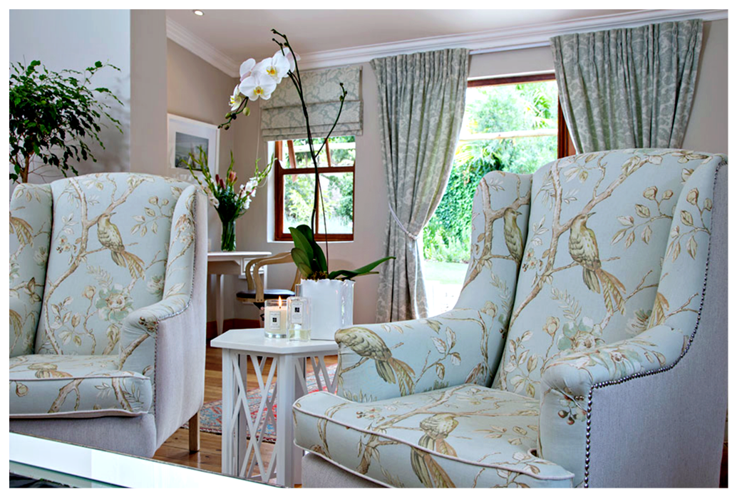 """Custom pinch-pleat curtains and roman blinds in a coordinating shade of duck egg blue, Collection  Andiamo  in """"Anastasia Spearmint"""",create the perfect backdrop to the room."""
