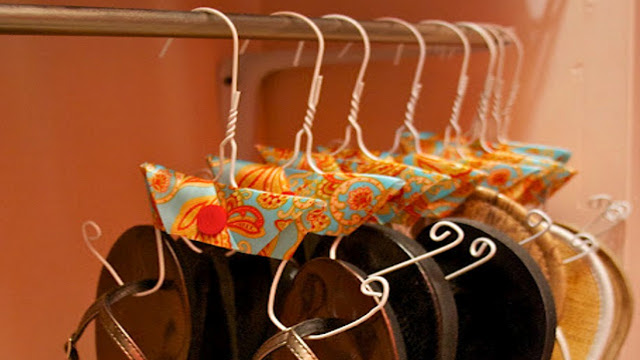 Sandals taking up too much space? Hang a rail close to floor height at the back of your wardrobe and consider hanging your sandal collection - problem solved!