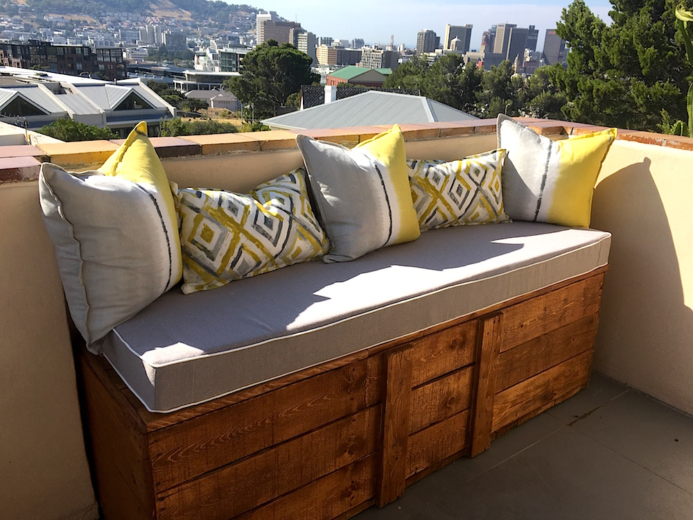 A wooden bench adds loads of seating in a tone and style that works with the existing tile work.