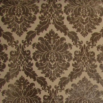 DAMASK | A figure jacquard woven fabric in which the weft forms the design and the warp, usually in satin weave, the ground. Most furnishing damasks have a right and wrong side but some are reversible. The design may be floral or geometric. Usually used for drapes, but is suitable for light upholstery.