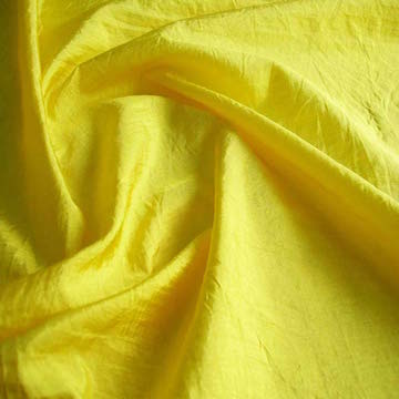 NYLON | A synthetic fibre known for it's strength, resistance to abrasion, inherent elasticity and relatively low cost. Nylon has a tendency to pill, and can attract soil because of static electricity.