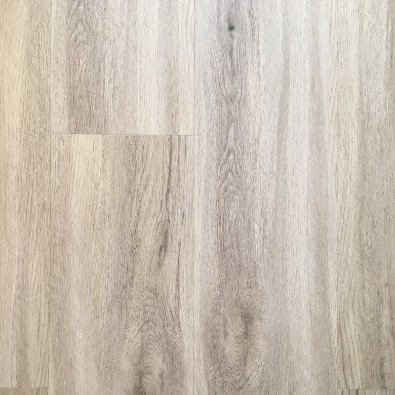 A laminate floor replaced stained carpets, adding a modern, light finish that is easy to clean and maintain. Laminate flooring provides a budget-friendly alternative to real wood floors.