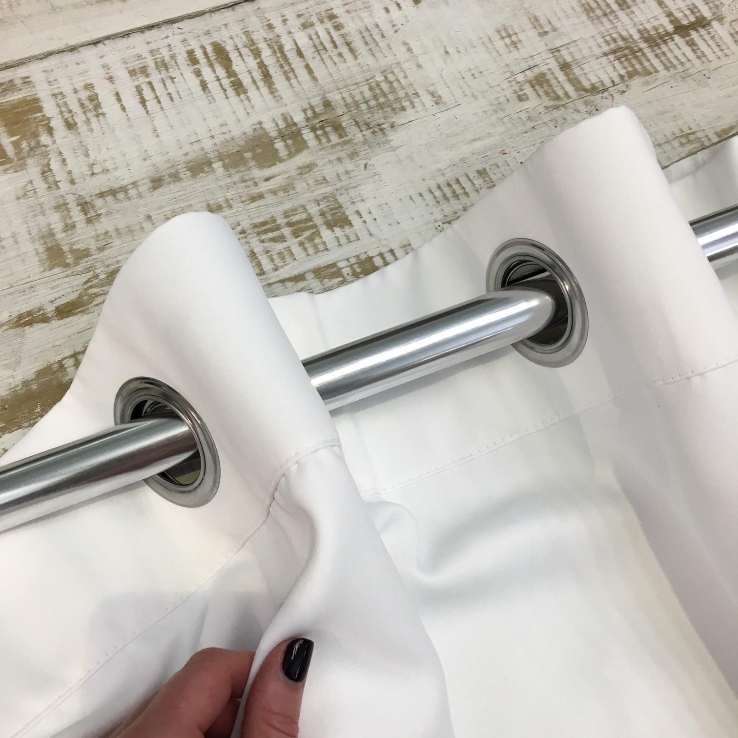 STEP 4 - Thread a single curtain pole through both eyelets as usual.