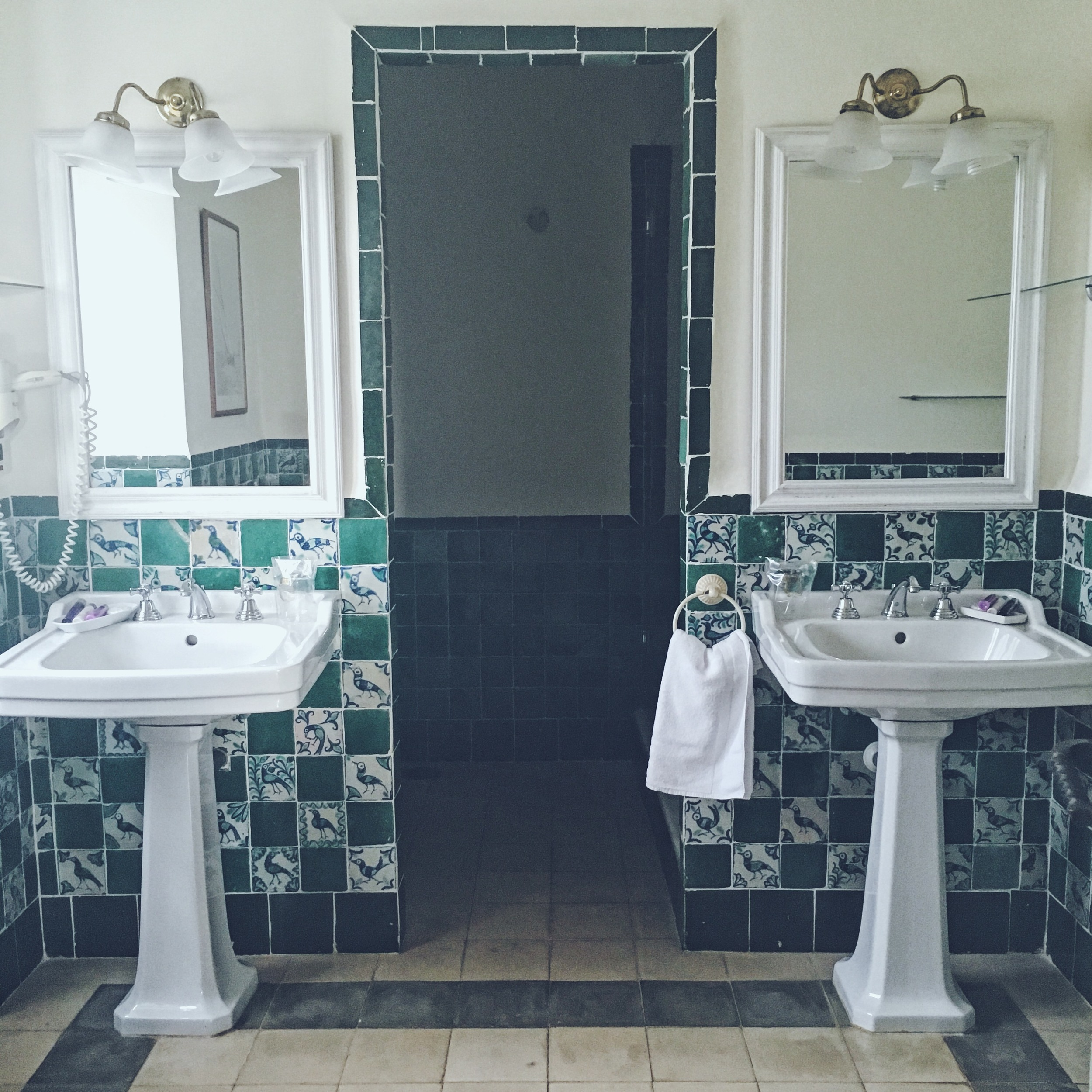 Castello De Santa Bathroom - how beautiful is the white porcelain & bottle green tiles.