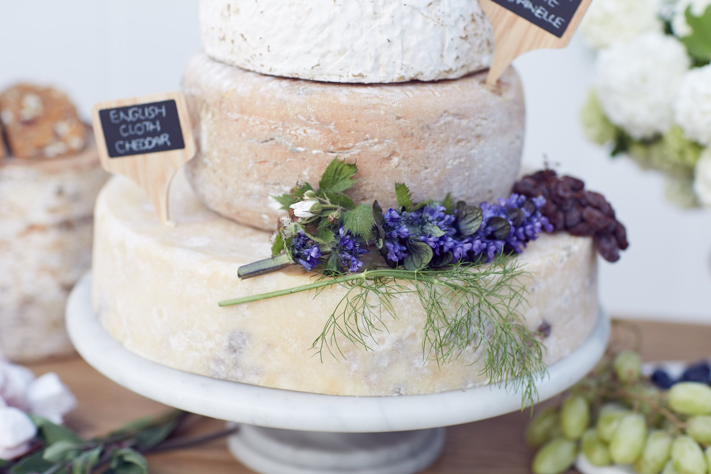 Cheese Wheel wedding cake by Lost In Love Photography