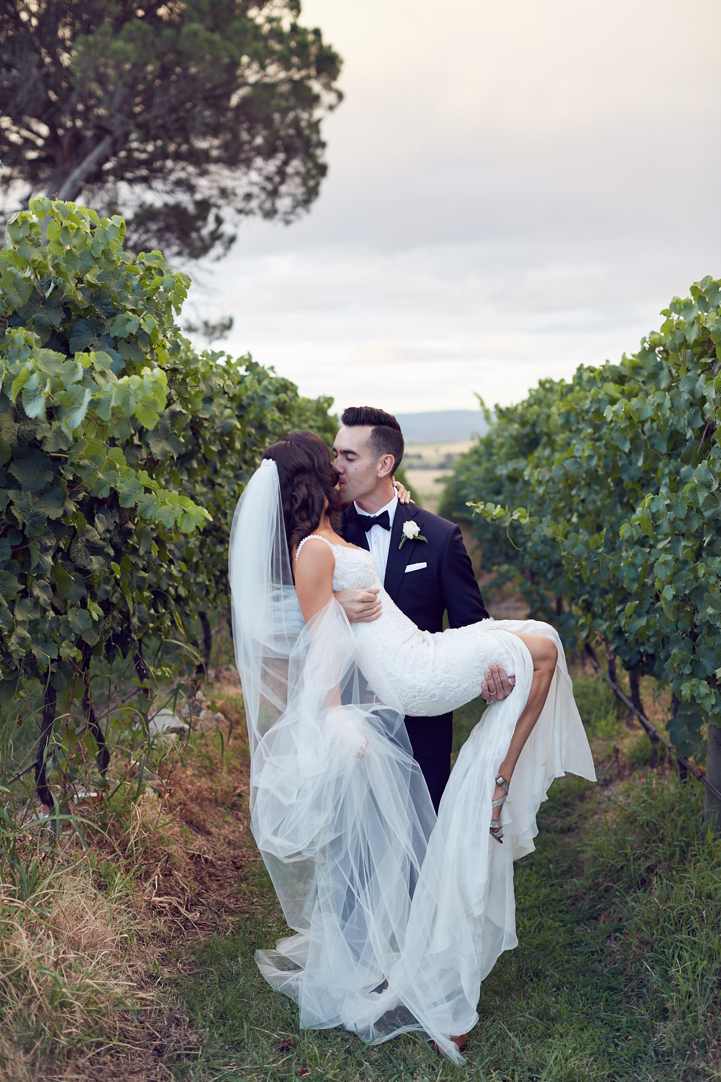 In amongst the grape vines at Stones Of The Yarra Valley, these two enjoyed a sun shower, rainbow, sunset and a big smooch!