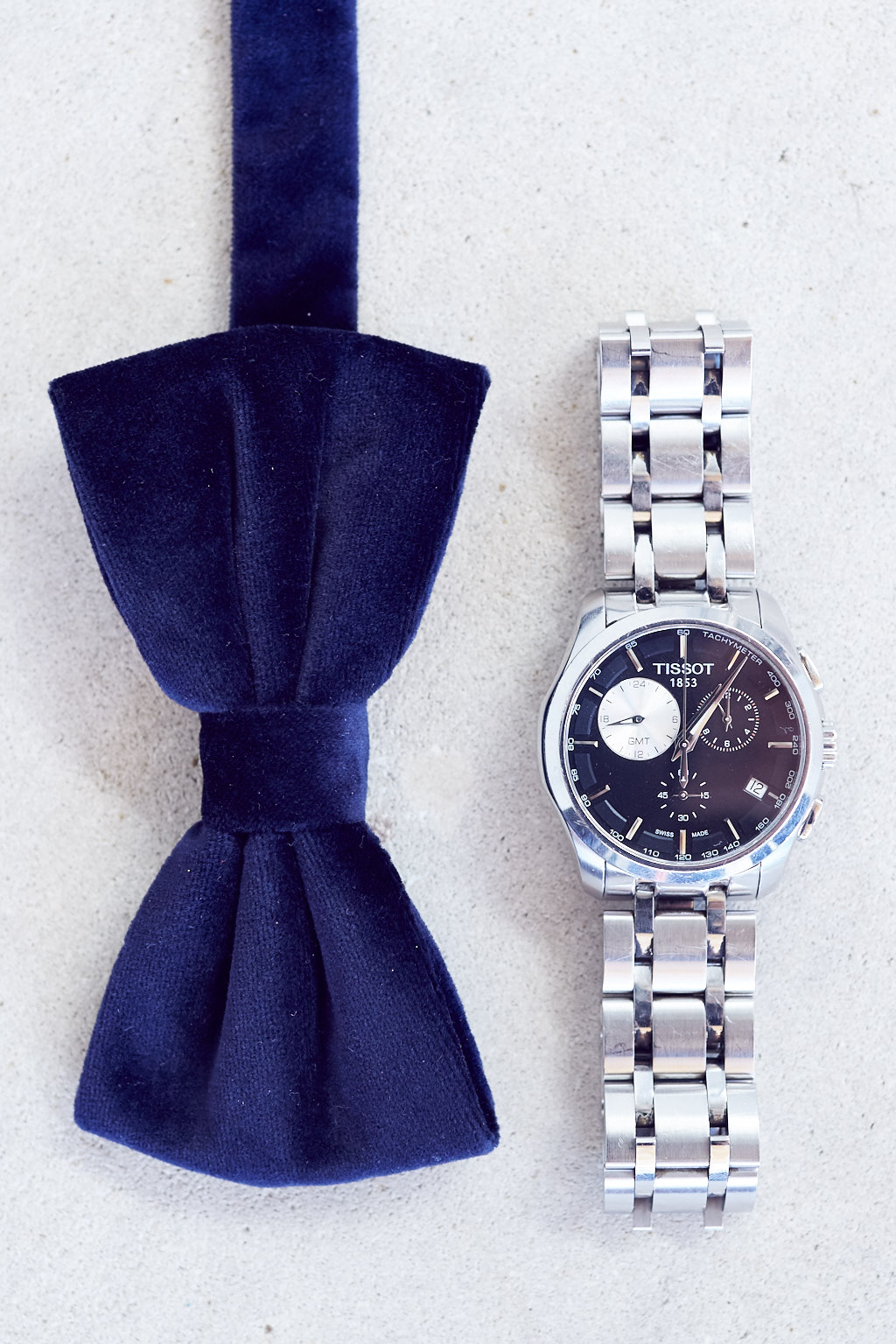 Tissot Timepiece paired with a velvet blue bowtie.