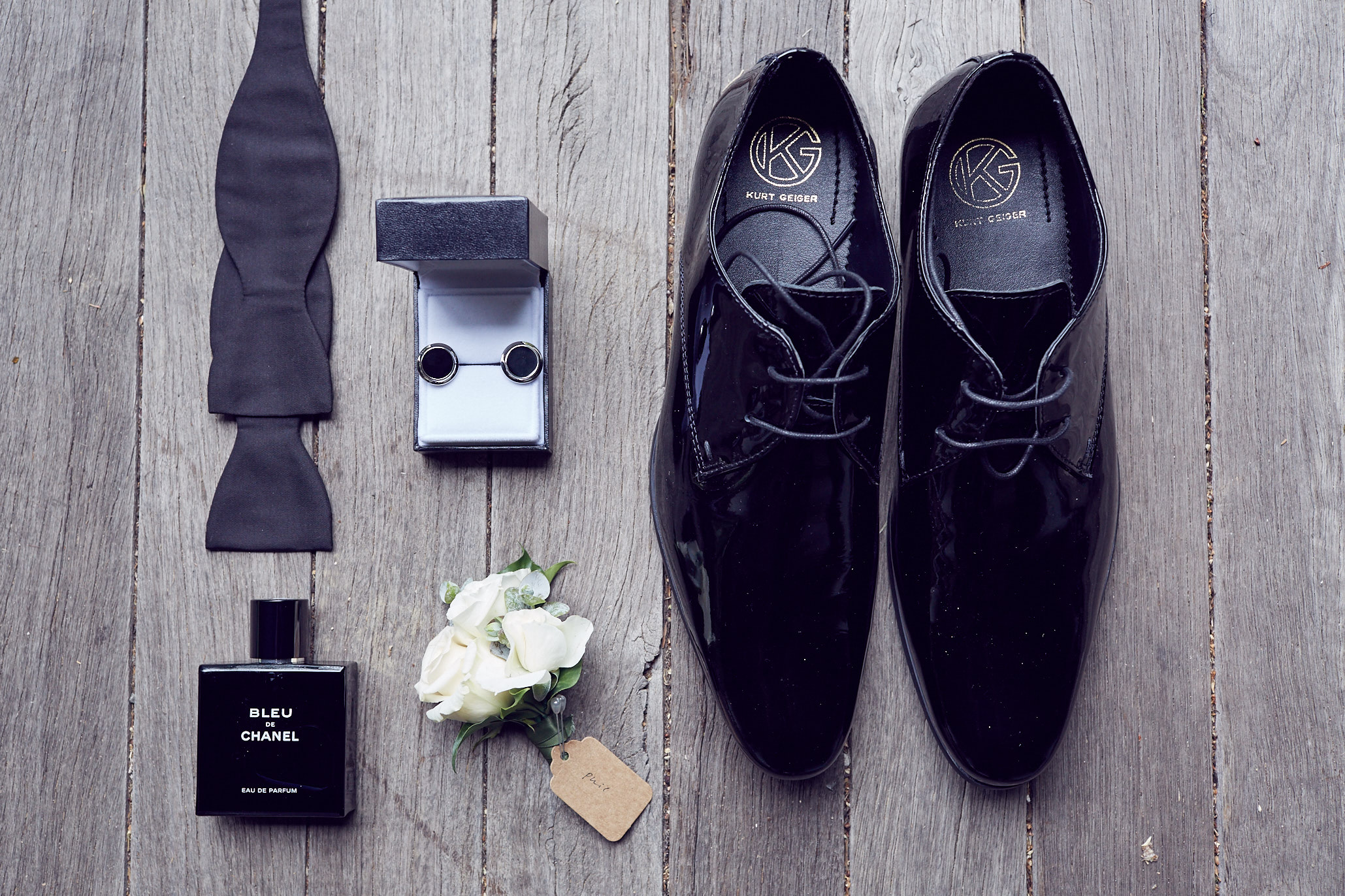 Kurt Geiger Shoes, Chanel Bleu cologne, triple rose bud, white boutonniere, Montblanc cuff links & hand tied bow tie.