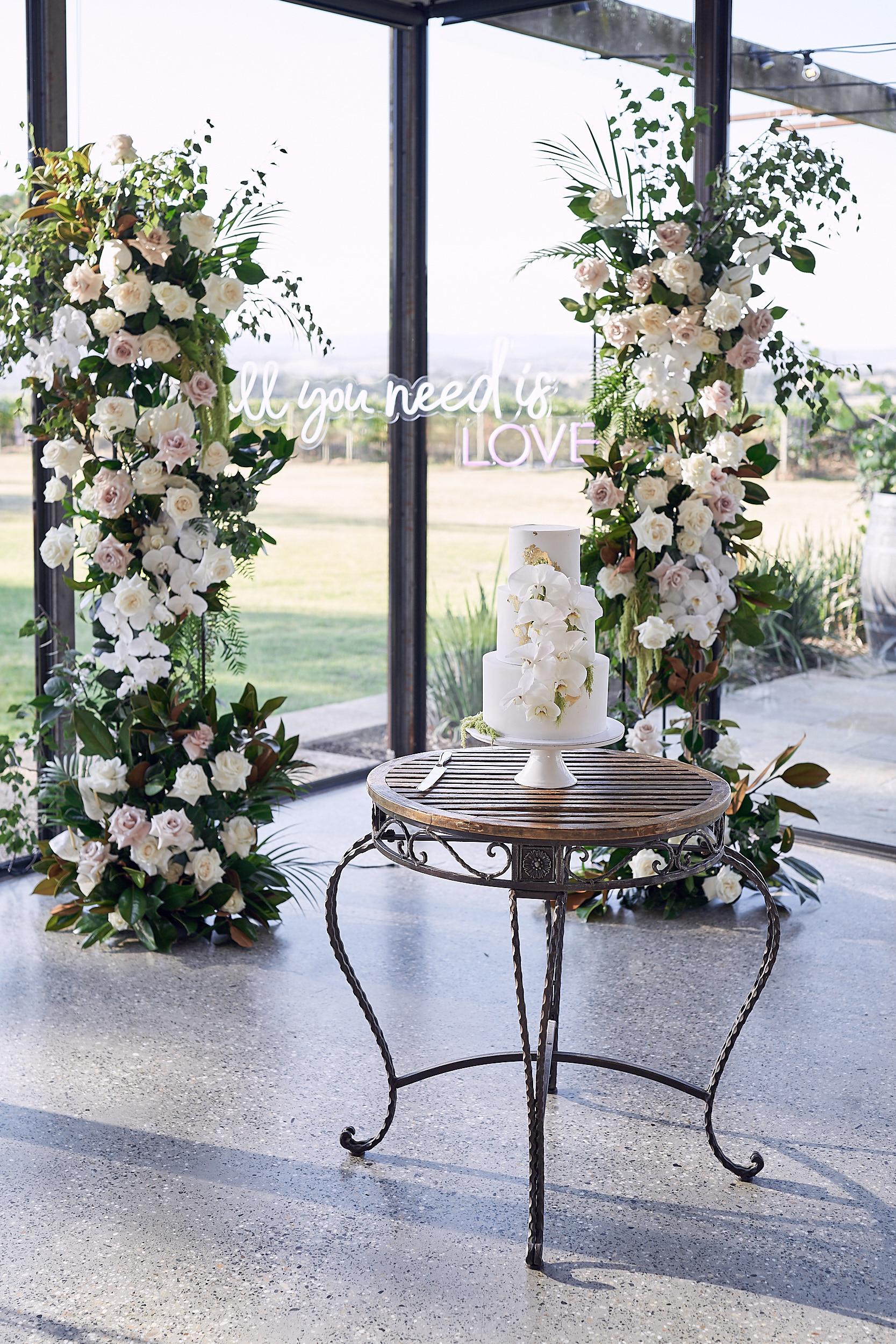 wedding cake with gold foil and orchids Stones Of The Yarra Valley by Lost In Love