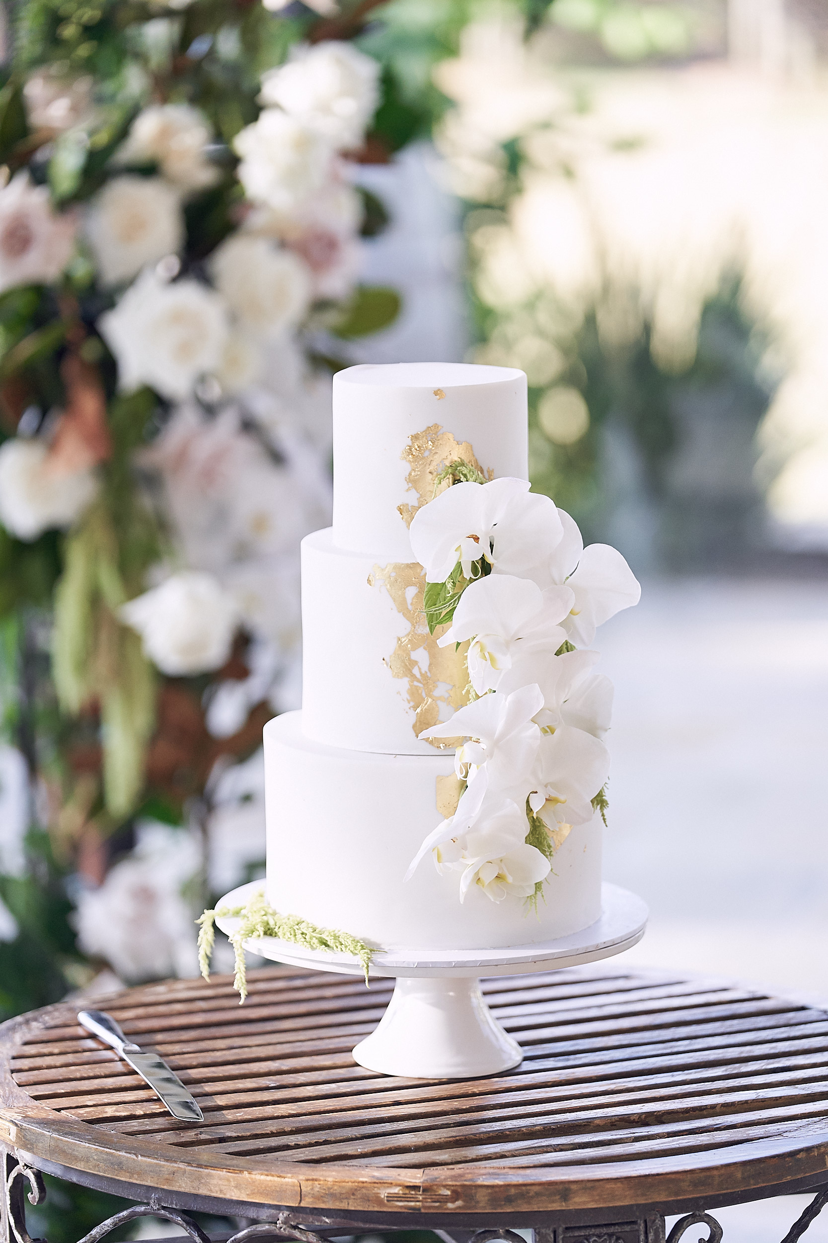white wedding cake with gold foil and orchids Stones Of The Yarra Valley by Lost In Love