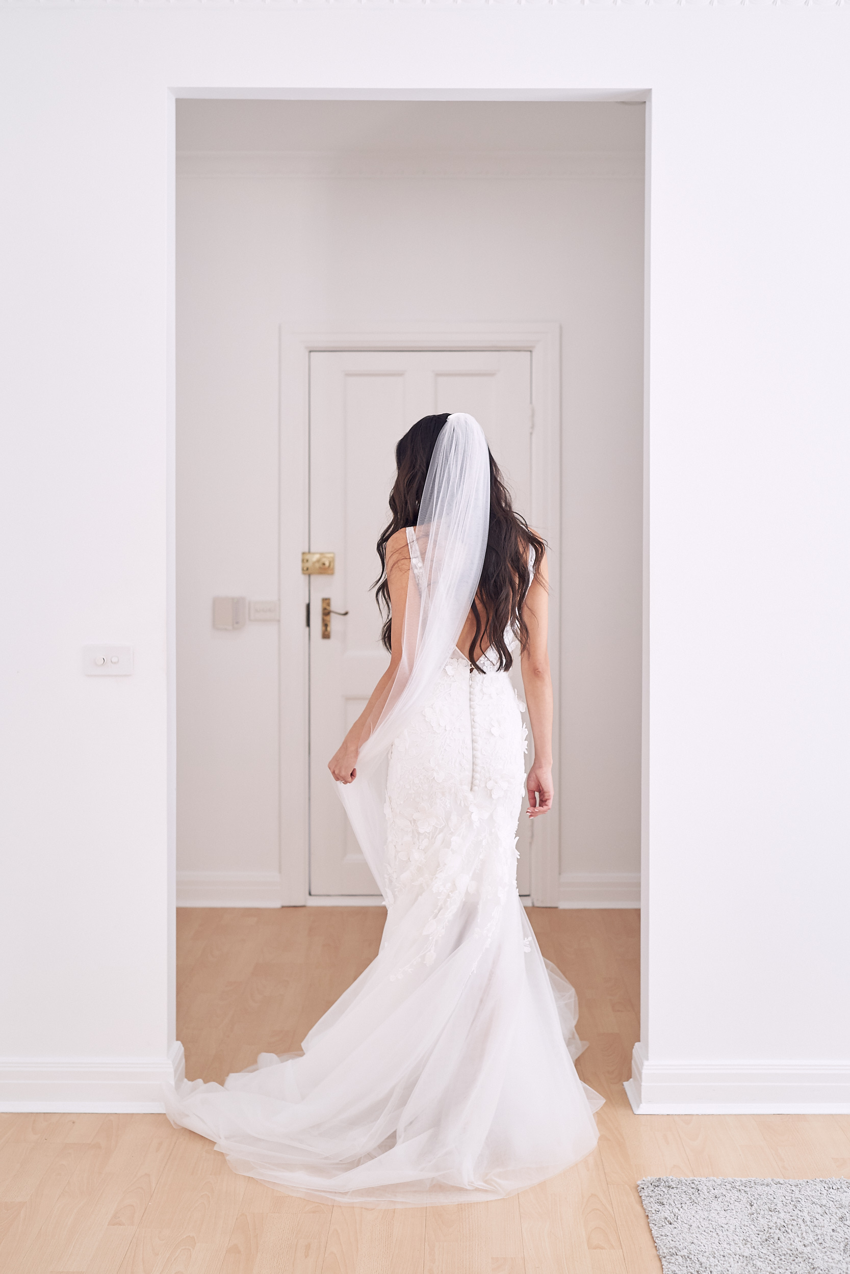 Simple wedding dress by Helen Manuel. Photo by Lost In Love Photography