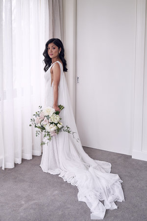 8b30ad5b498 simple wedding dress by Mariana Hardwick. Photo by Lost In Love  Photography. Sugarbee Flowers