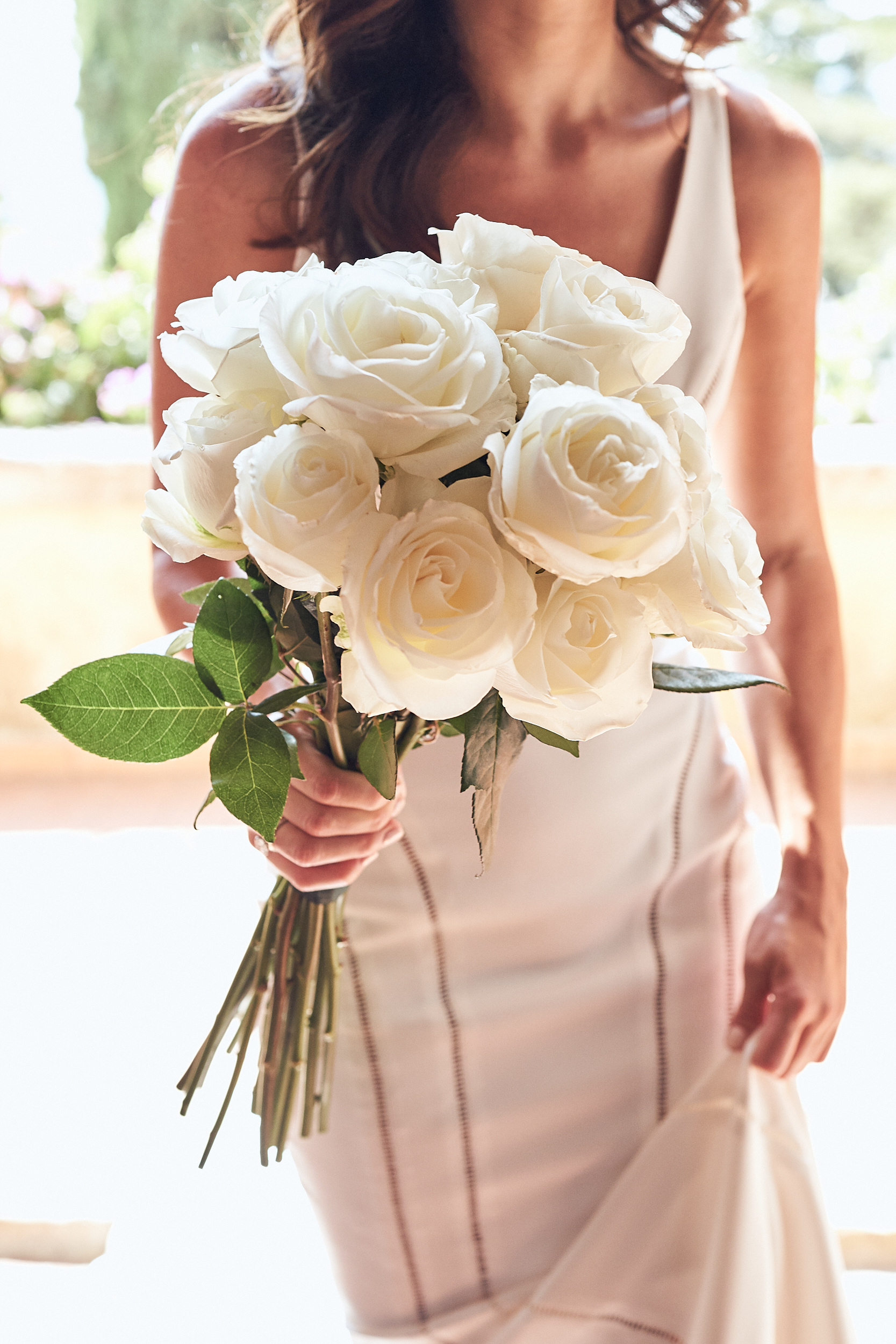 bride flowers at a Destination Wedding Tuscany by Lost In Love Photography