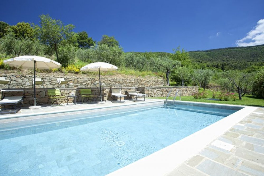 cortona-villa-pool-lounges.jpg