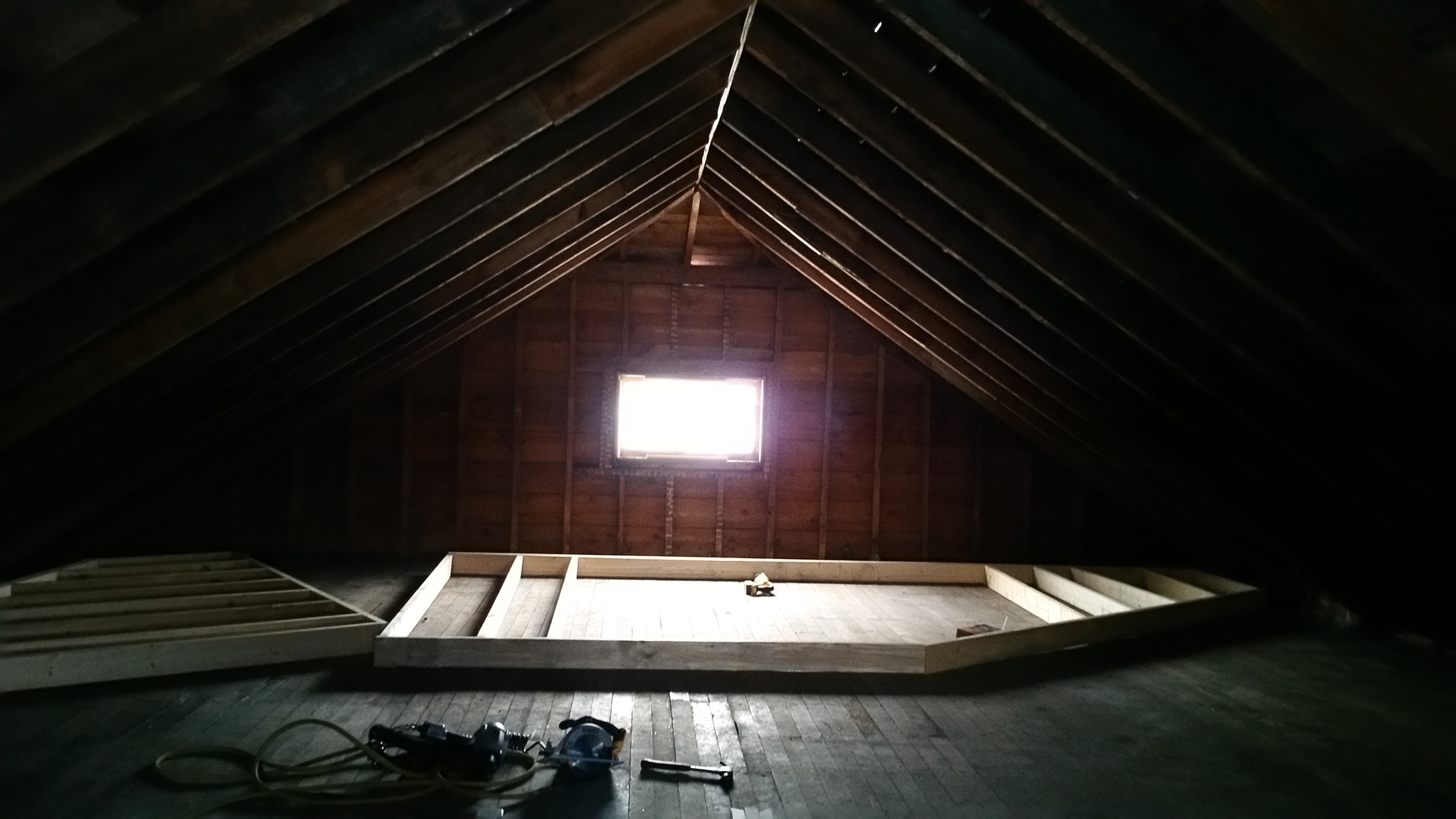 Exterior walls being assembled in attic
