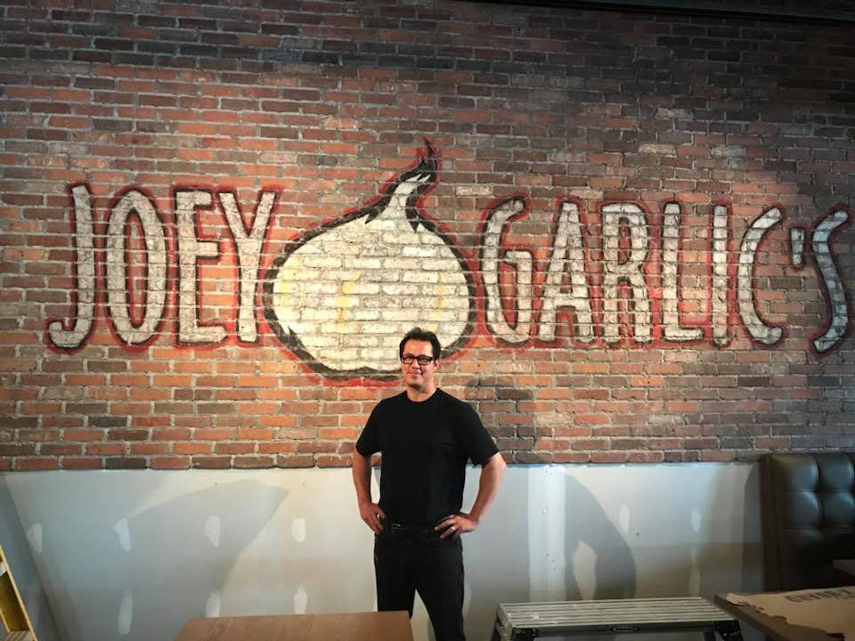 Joey Garlic's logo wall. No dogs are painted in this mural :-)