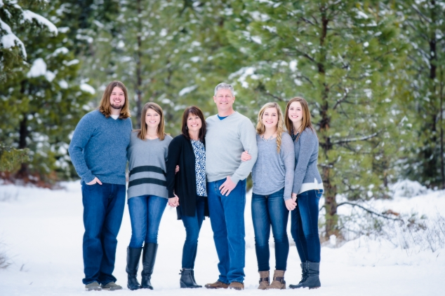 This family has stayed pretty safe with a blue and gray color palette, and added in a few stripes and one texture. They look relaxed and comfortable, all while looking dressy enough for family photos - letting their natural smiles shine through. | Photo credit:  shawnabensonblog.com