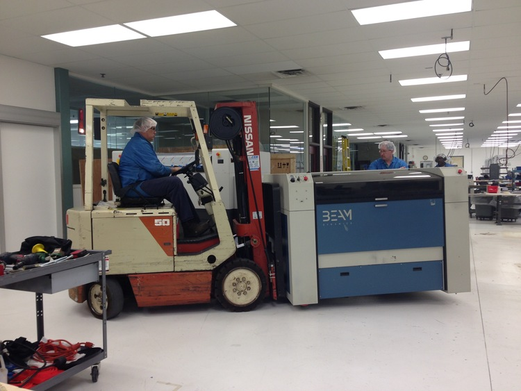 Old laser being moved out