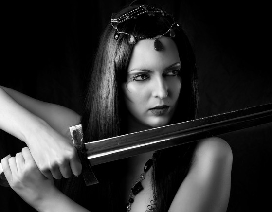 bigstock-Young-Sexy-Woman-Warrior-Holdi-35264363.jpg