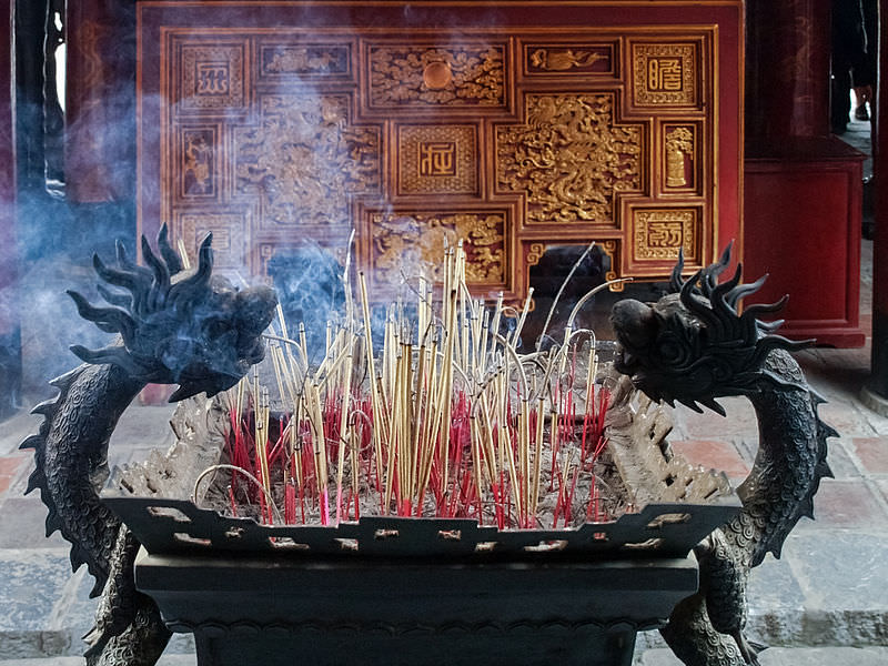 Incense burning at the Temple of Literature, Hanoi. Photo by  Myrabella