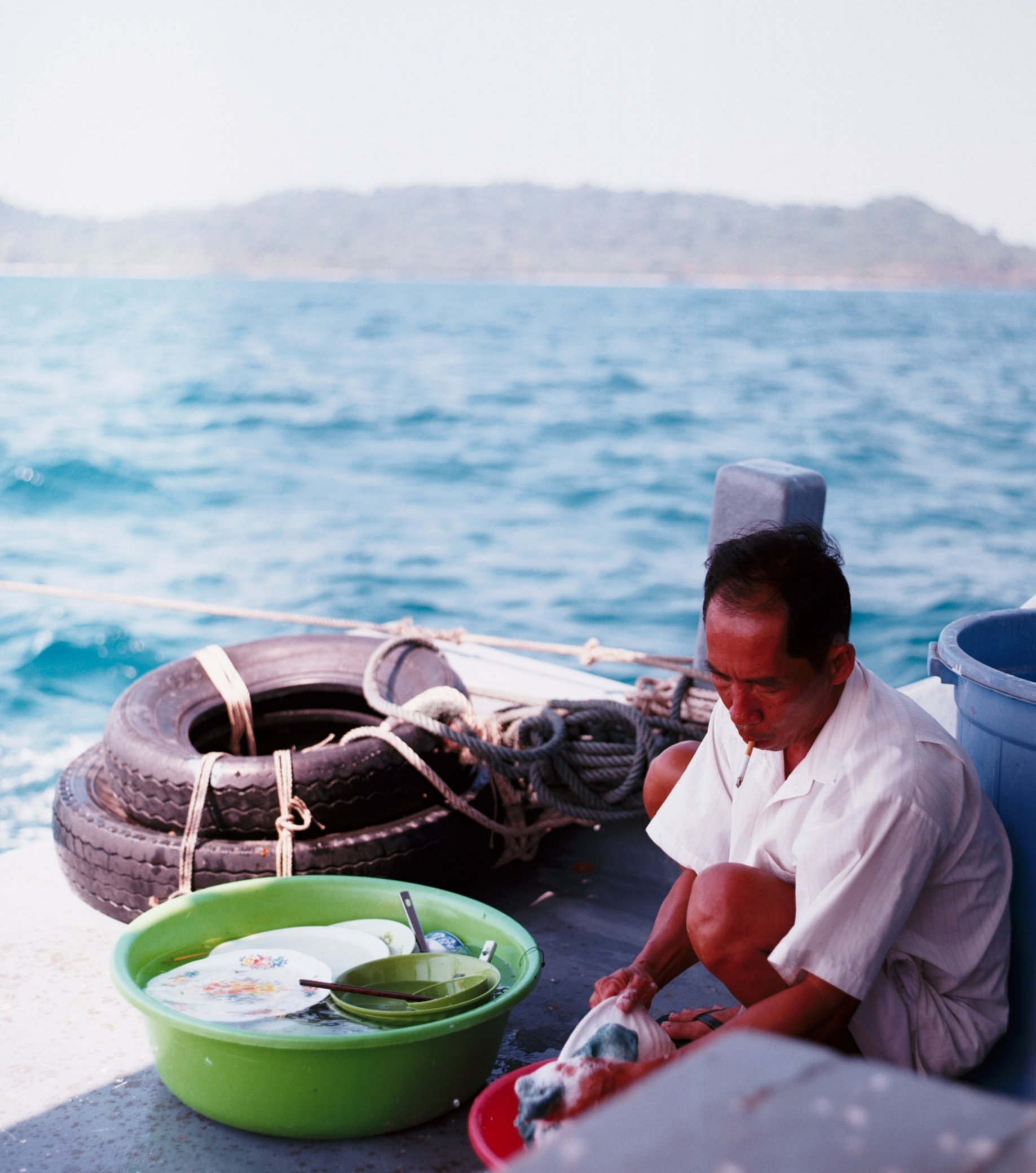 Washing the Dishes at Phu Quoc, Viet Nam. Photo by  Geoffrey Arduini .