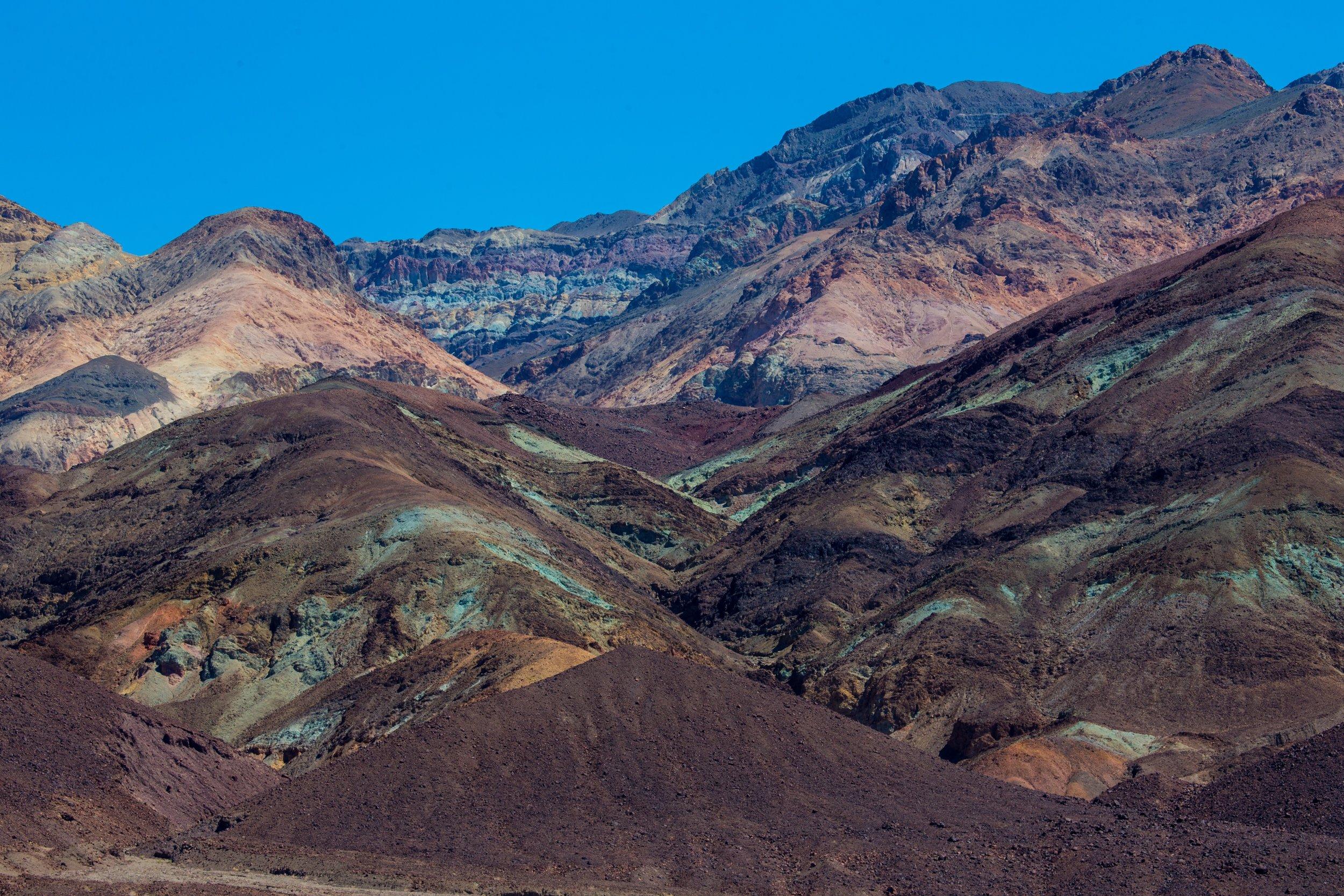 Streaks of mineral beauty in Death Valley, USA. Photo by  Anchor Lee .
