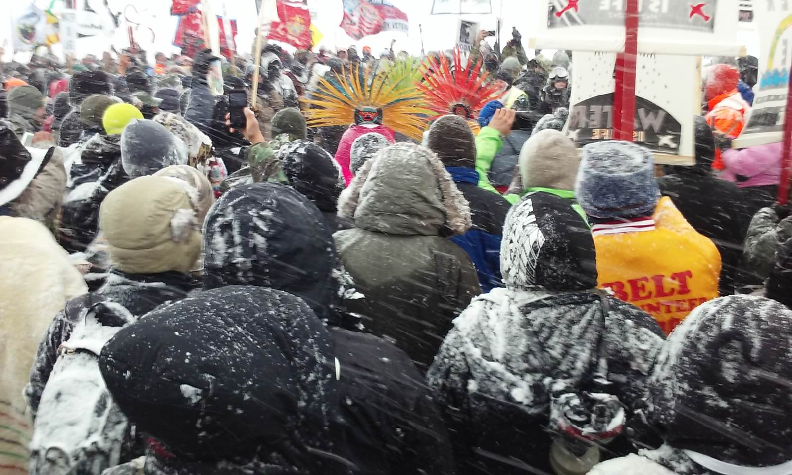 Photo of the water protectors, strong in the snow at Standing Rock by  Kim Chee .