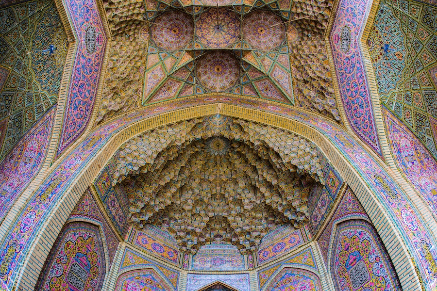 Wealth accumulated (and art crafted) in the name of religion. The magnificent mosque gate at Shiraz, Iran. Pic by  Steven Su .