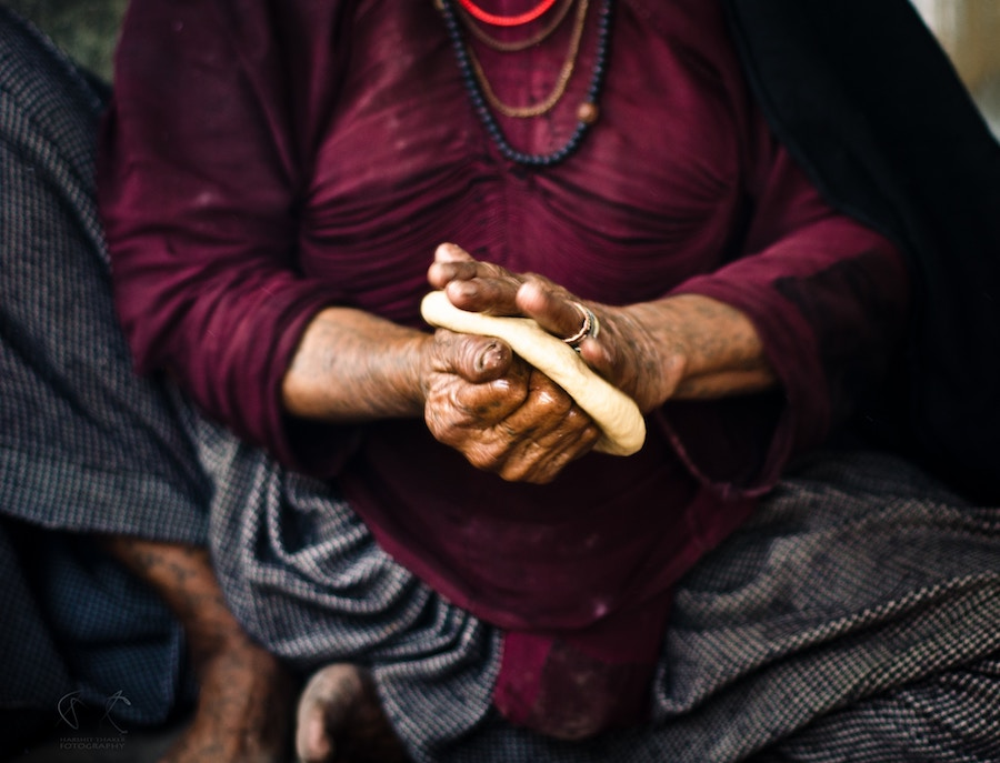 Tribal woman making bread in Western India. Photo by  Harry Thaker .