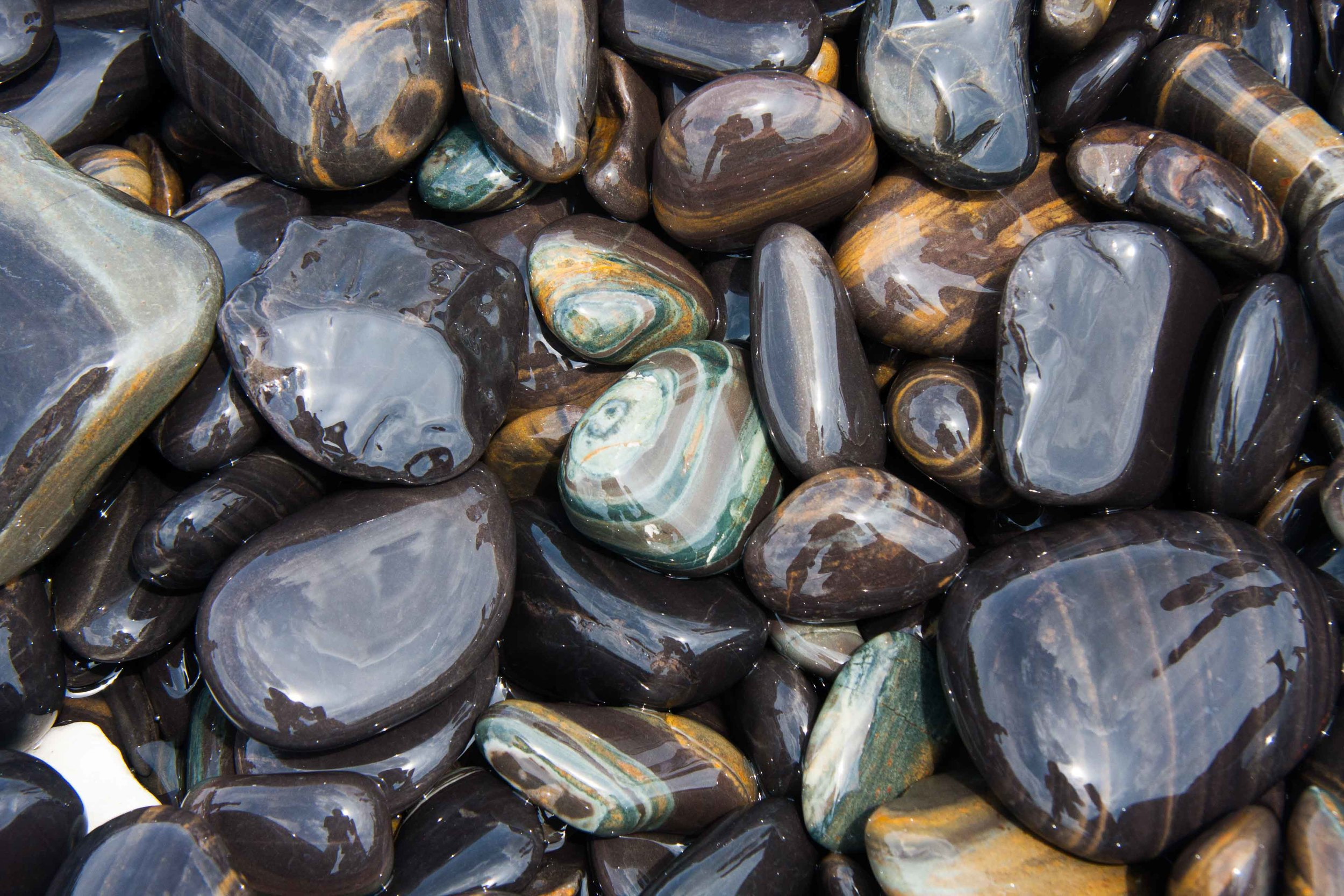 Sea-polished stones on the shores of southern Thailand