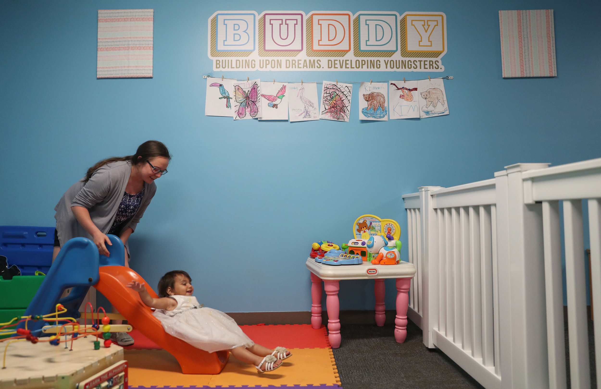 The BUDDY Program provides spaces for children ages one to seven. BUDDY Serenity plays with a one-year old in the designated toddler space. Local businesses and individuals generously donated the equipment needed to make the toddler area a safe and fun space for our children.