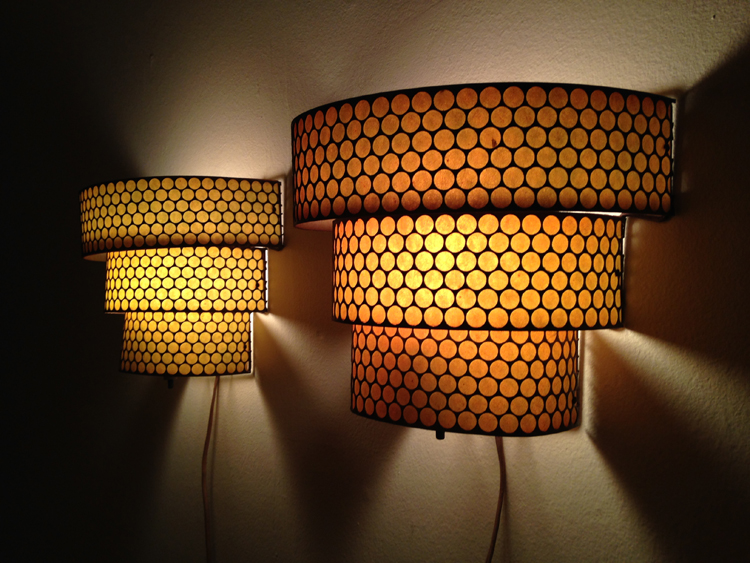 "Vintage Perforated Brass Art Deco Style Light Sconce Pair   Perforated brass 3-tier light fixtures with original patina, lined with fiberglass shade. Emits warm gold light (one is slightly darker gold). Both in working order with original electrical cords.  10""wide x 8""high x 6""deep.   $85 for pair"