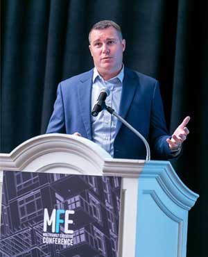 Michael Smith speaks at the MFE Conference last month.