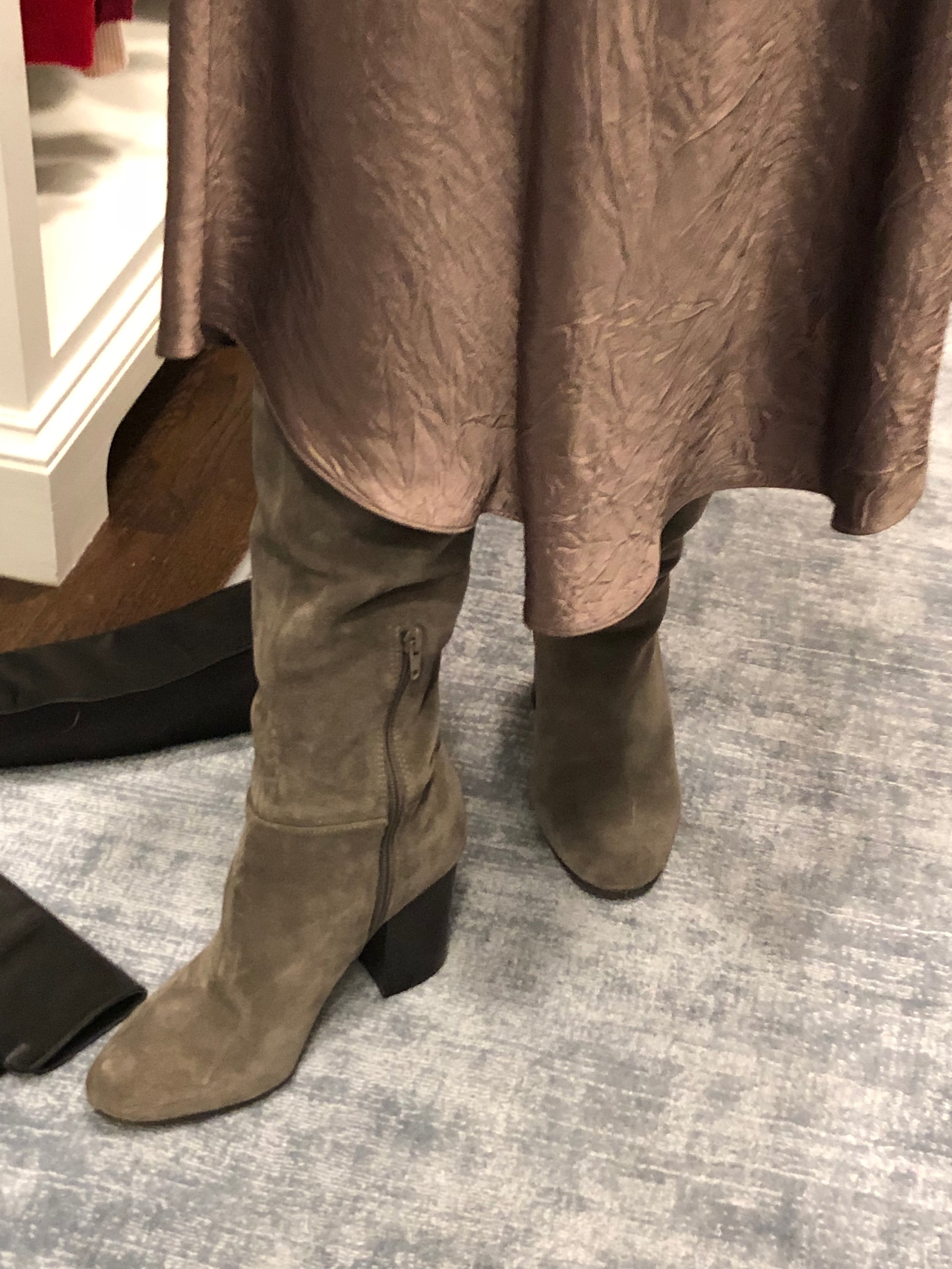 The skirt hangs over the boot