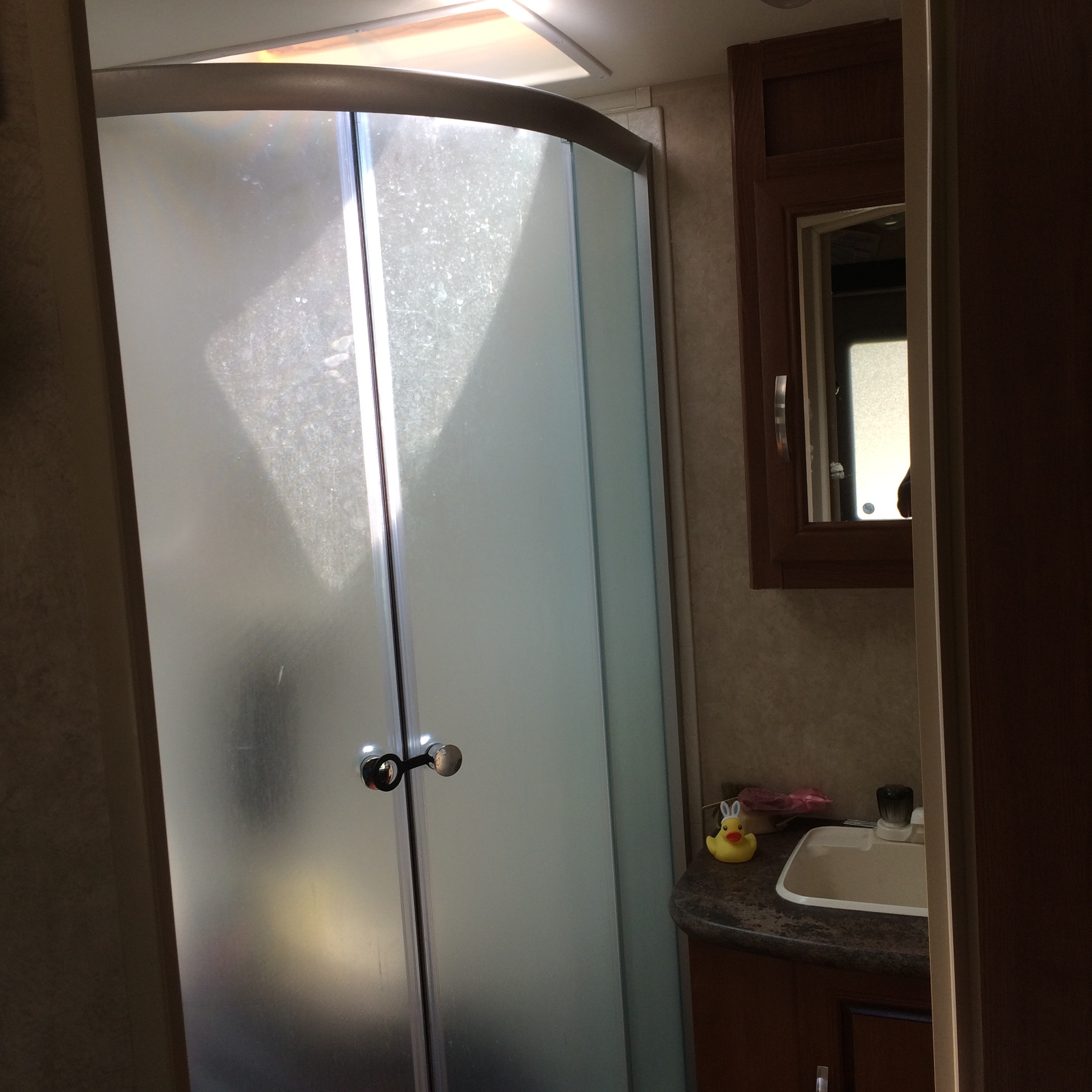 Surprisingly nice shower for such a little space. I hate being touched by shower curtains so I LOVE these doors!!!