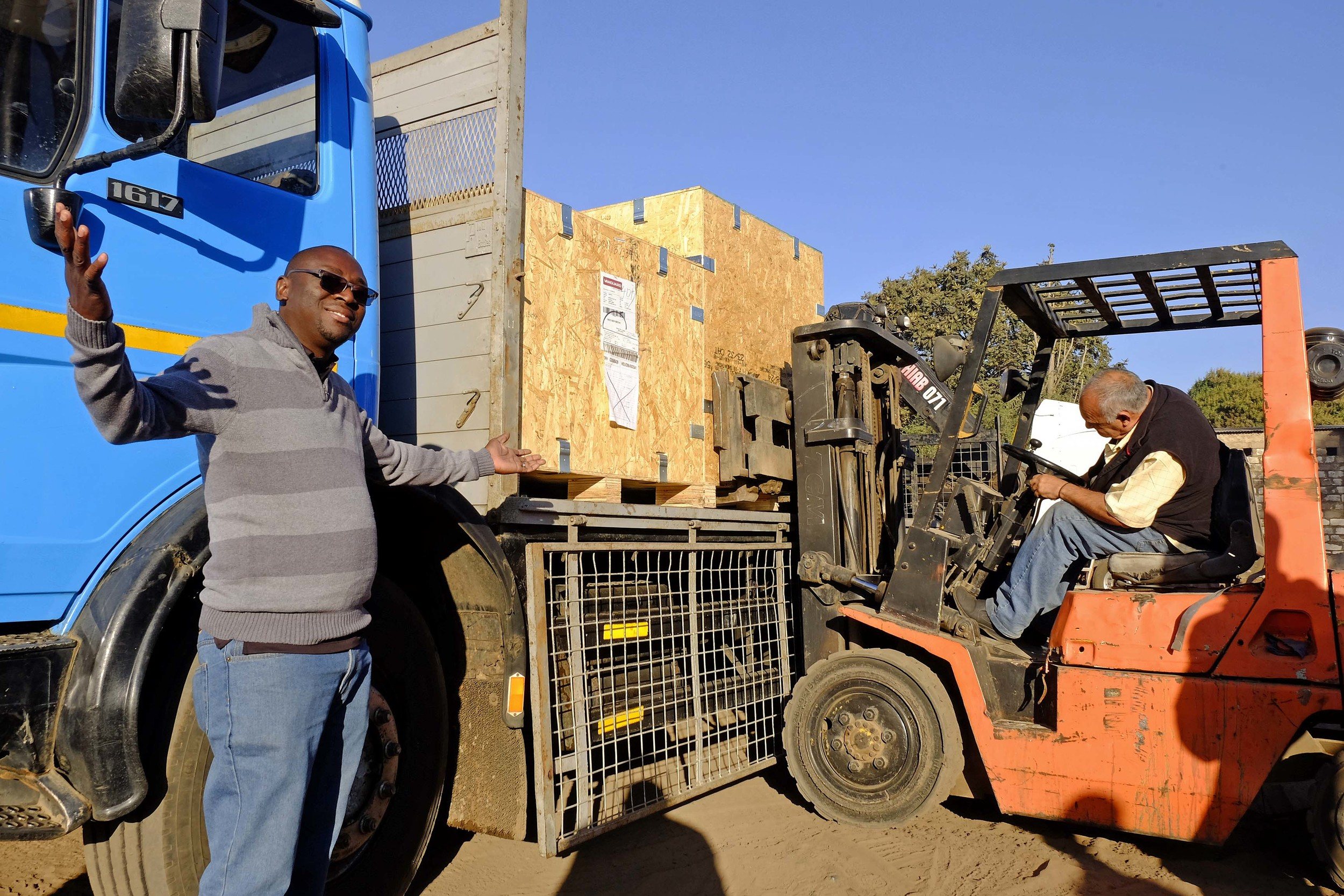 Percy Muleba welcomes the shipment from the U.S.!