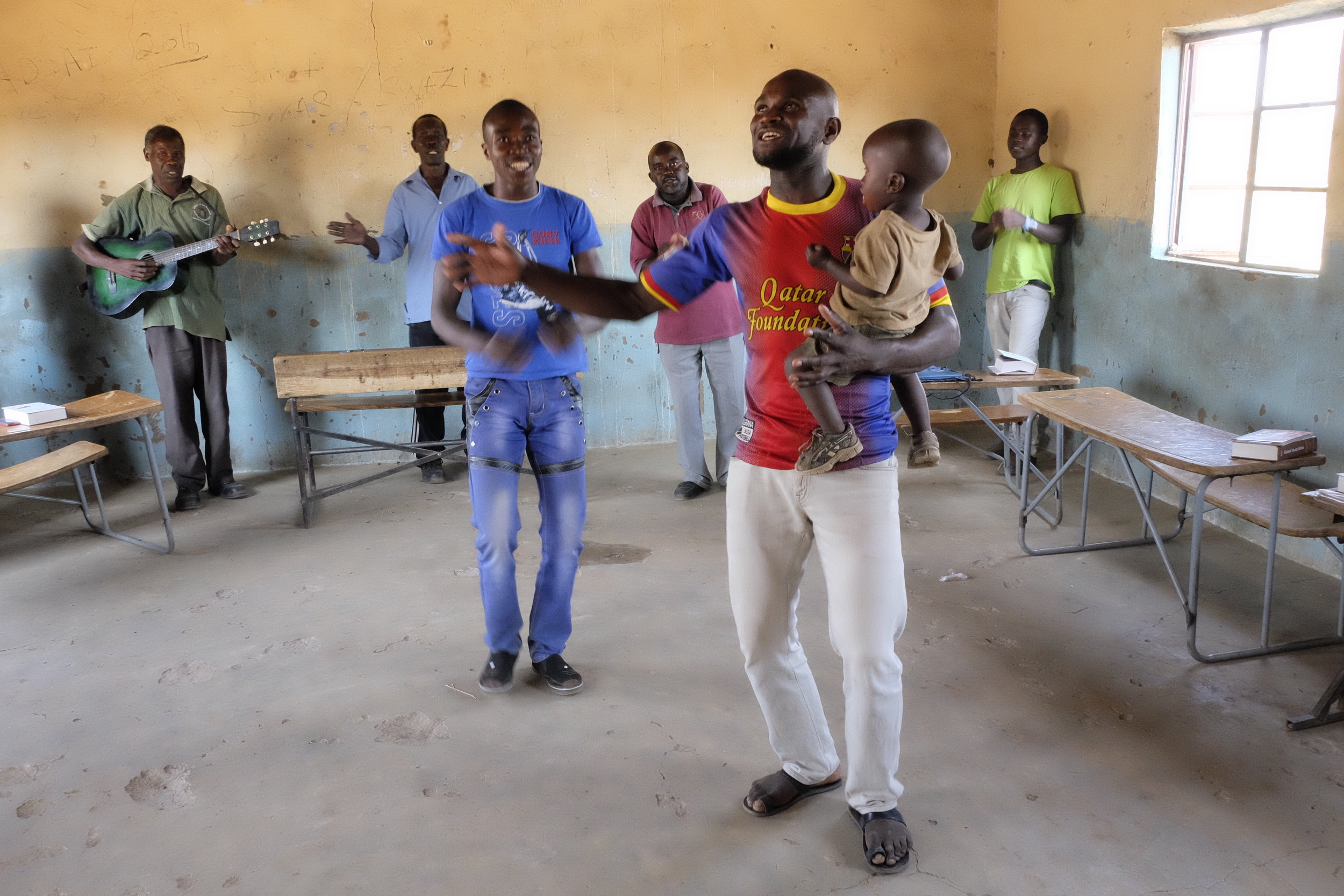 John joyfully leads worship with his son!
