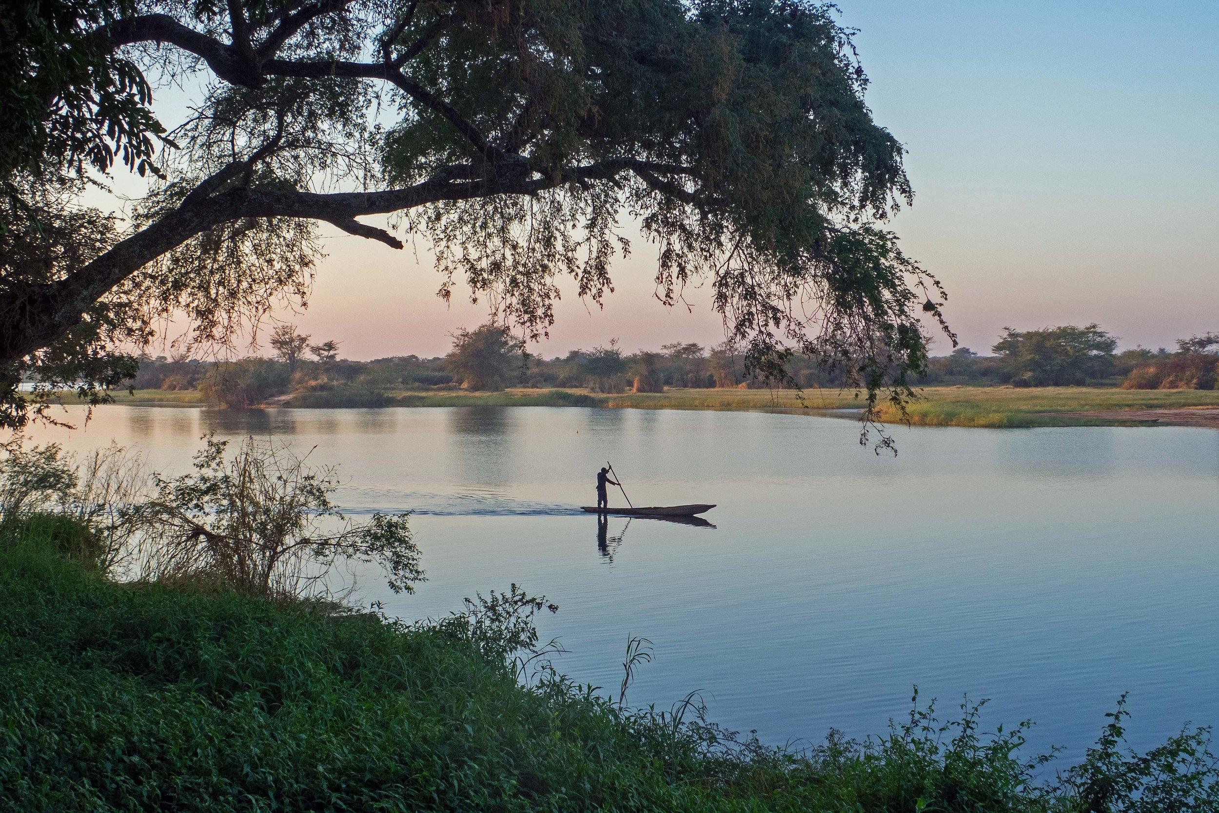 A Mwandi fisherman heads out at sunrise.