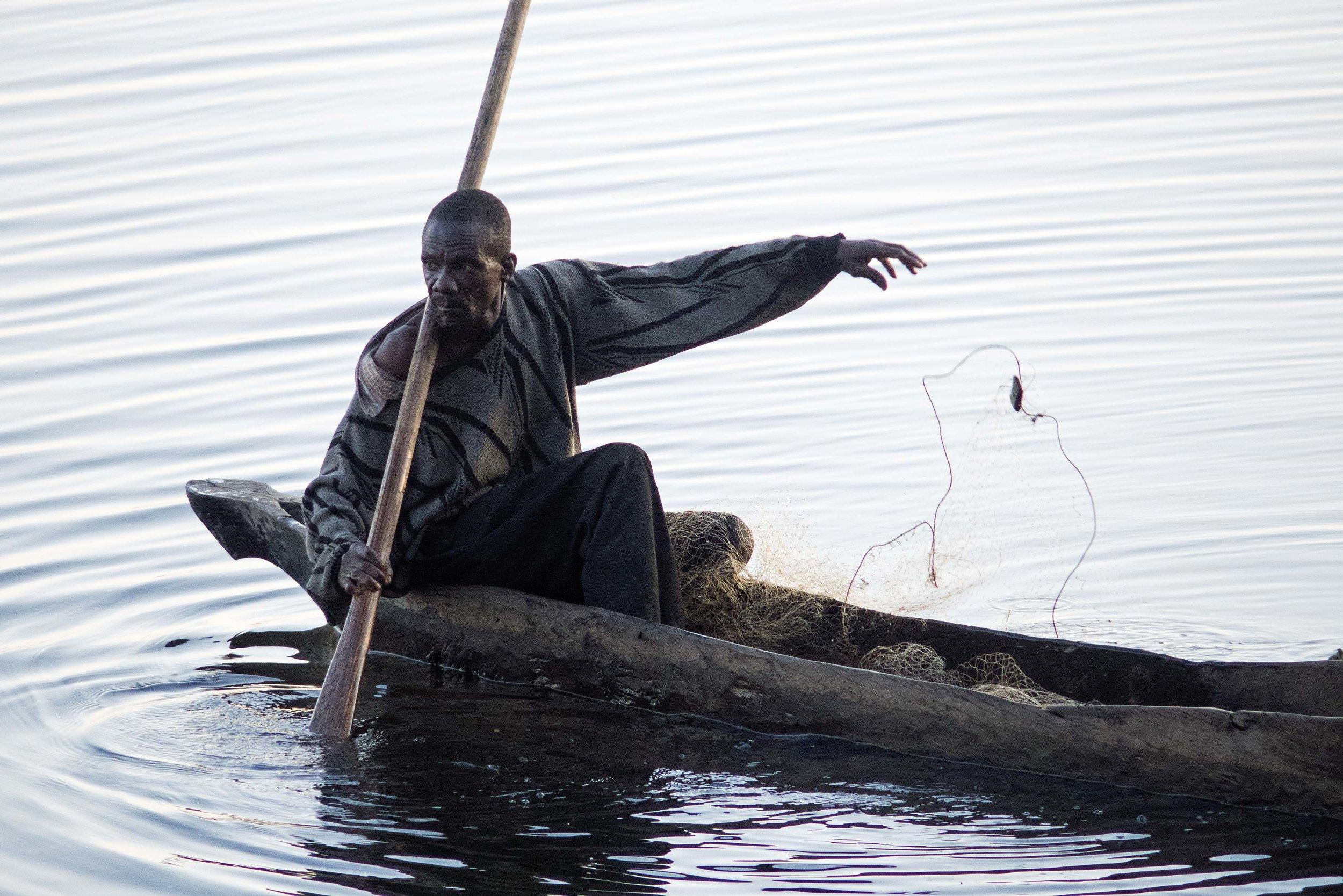 A Mwandi fisherman checks his net.