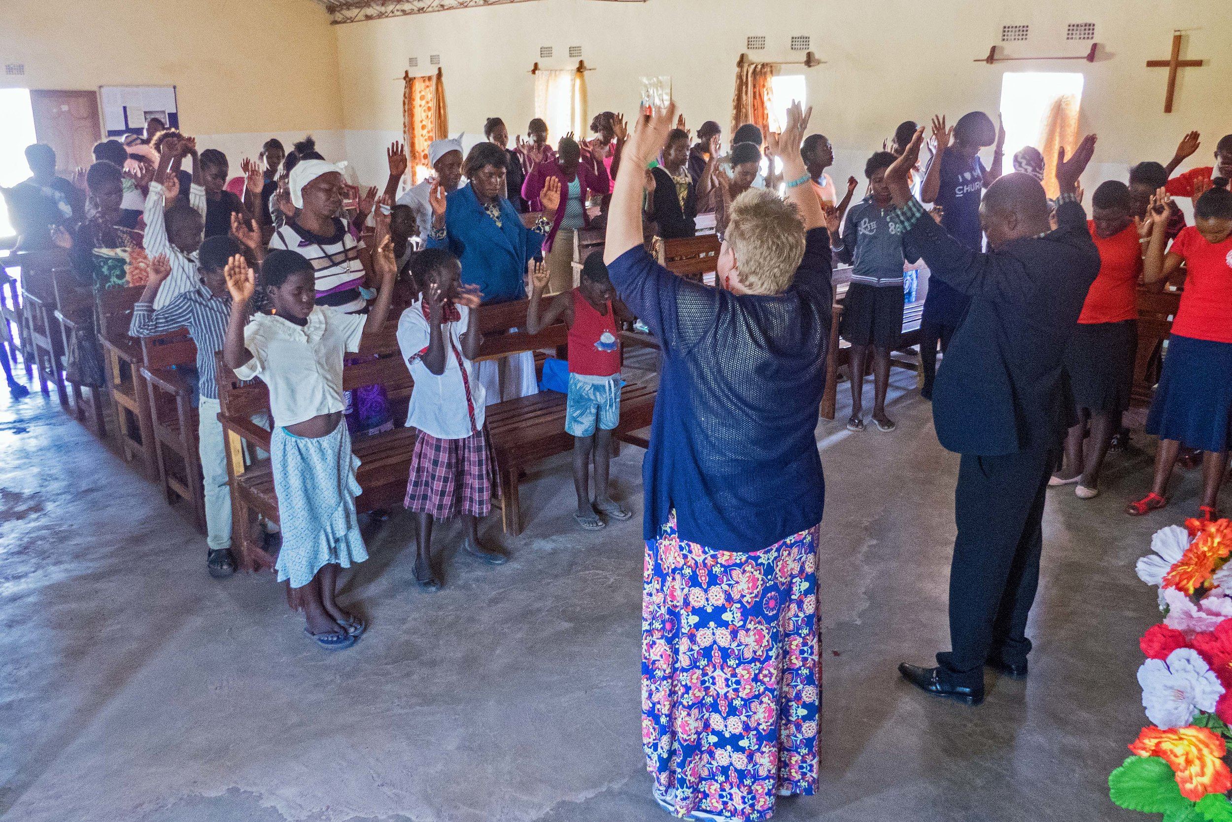 Abby leading prayer at Pilgrim Wesleyan, Pastor Mudenda's church.