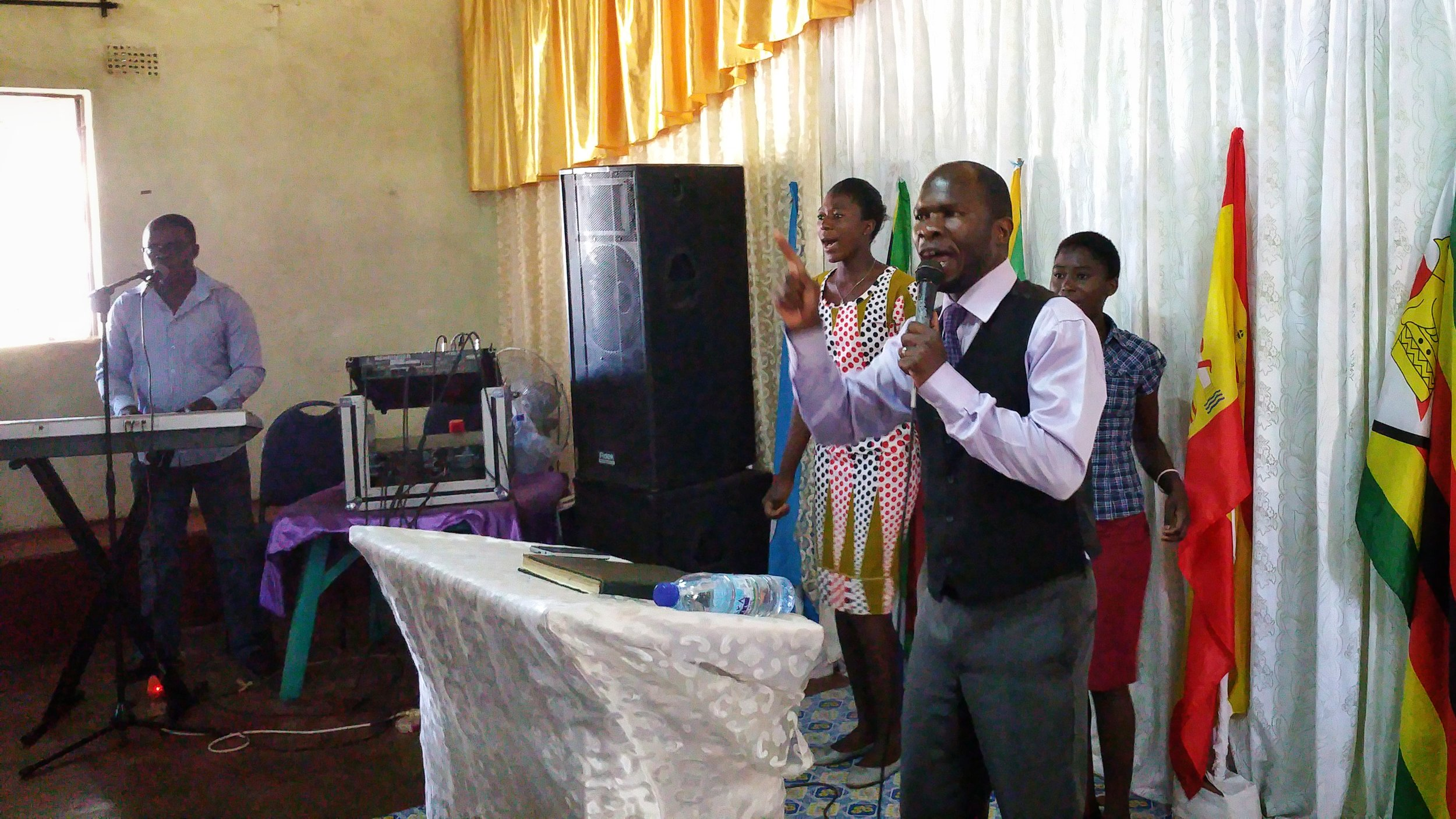 Pastor Fred leads worship at Kingdom Impact Ministry.