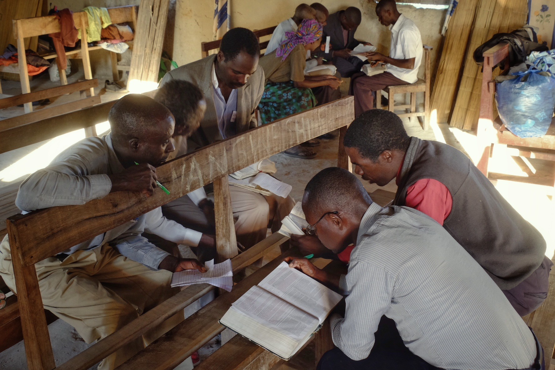 Students in Nangweshi, Zambia share Bibles as they search the Scriptures in a break out session.