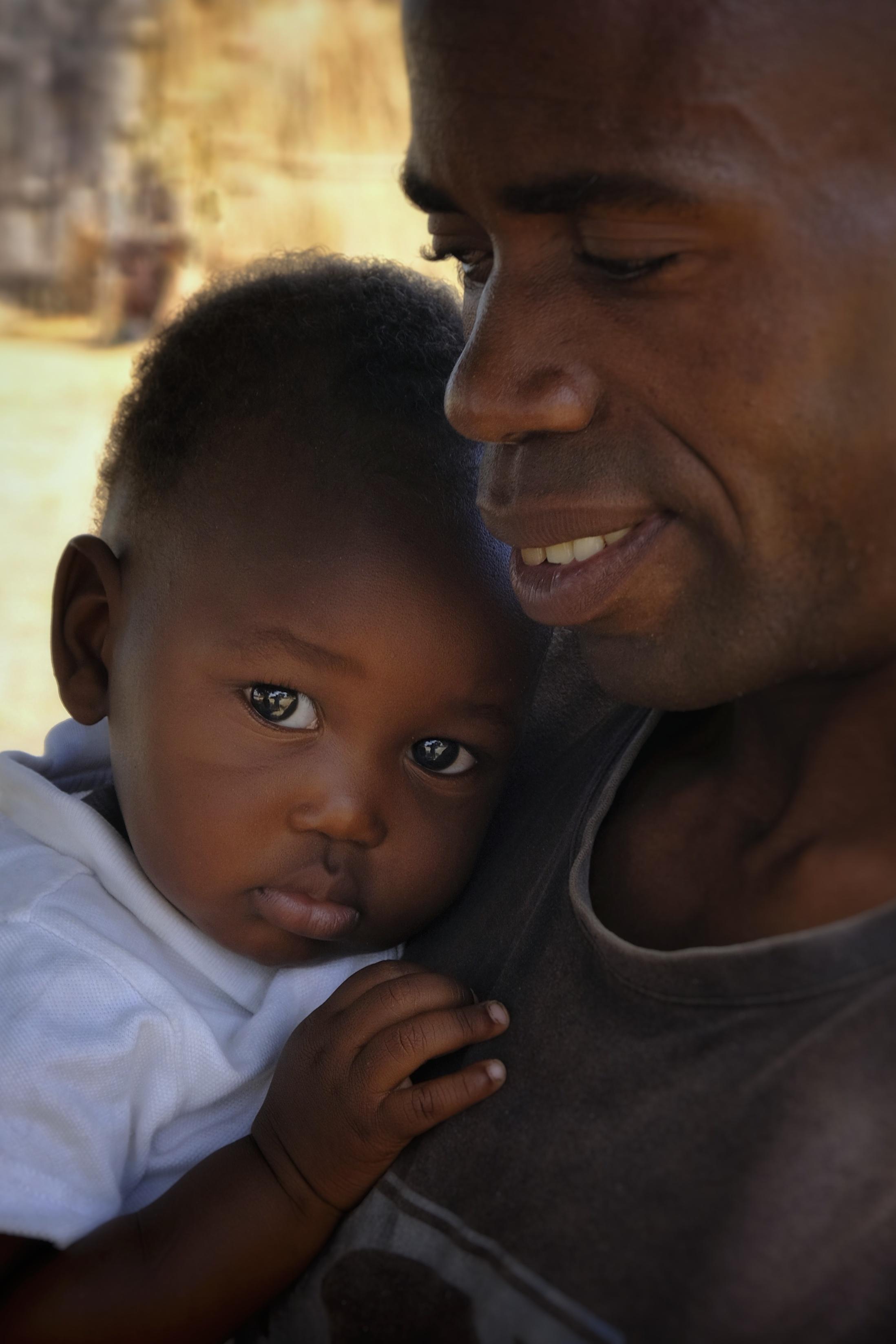 Pastor Titus Njamba holds his son, Douglas (Dougie), my namesake.